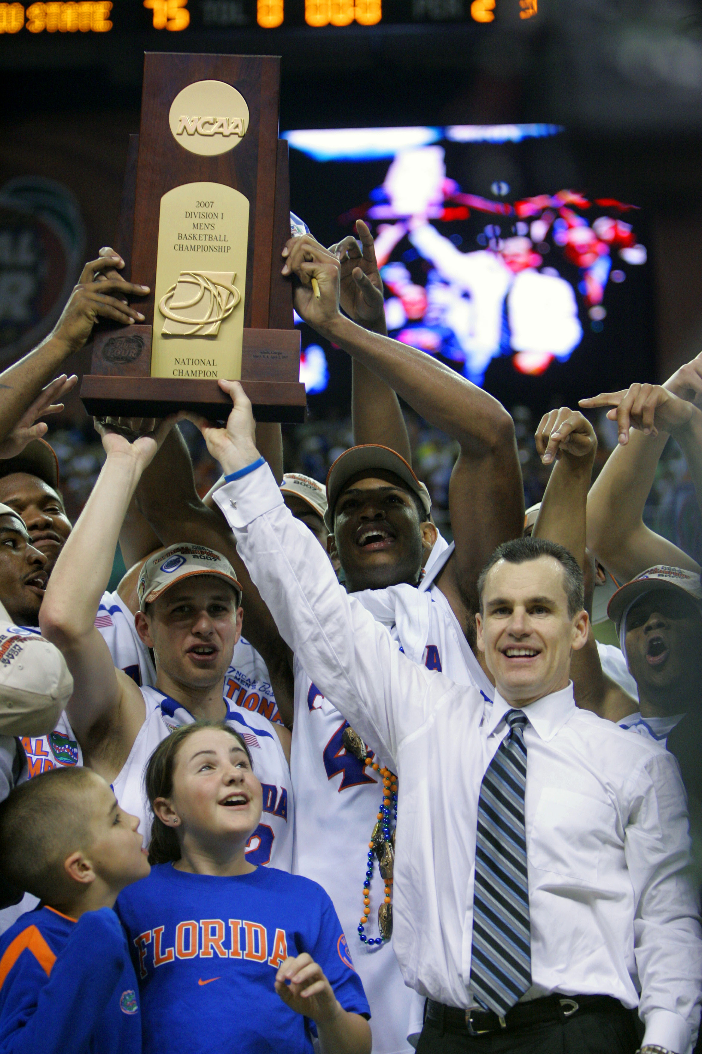 FILE - In this Apri 2, 2007, file photo, Florida coach Billy Donovan, right,  holds up the championship trophy after the defeated Ohio State 84-75 in the NCAA Final Four college basketball championship at the Georgia Dome in Atlanta. Florida has the tough