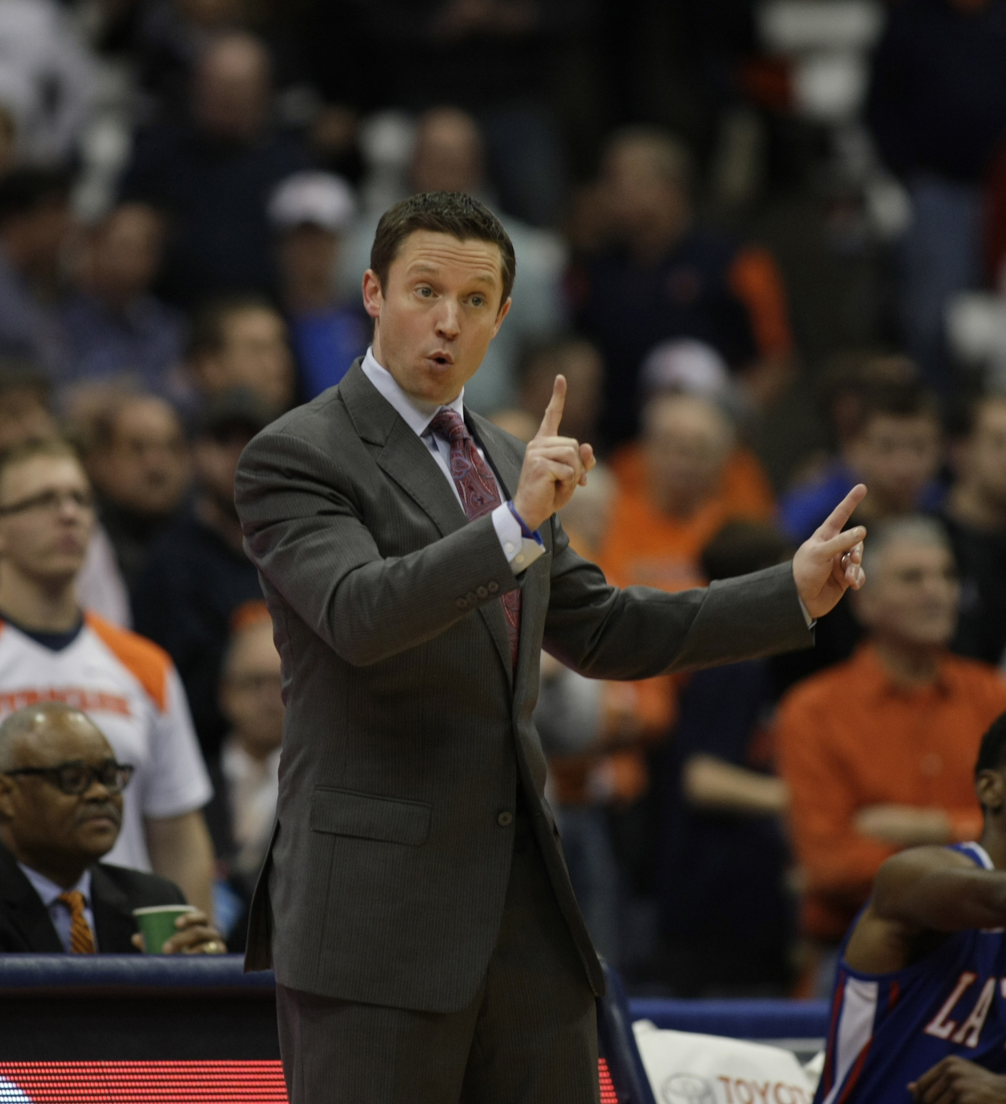 Louisiana Tech head coach Michael White signals to his players in the second half of an NCAA college basketball game against Syracuse in Syracuse, N.Y., Sunday, Dec. 14, 2014. Syracuse won 71-69. (AP Photo/Nick Lisi)