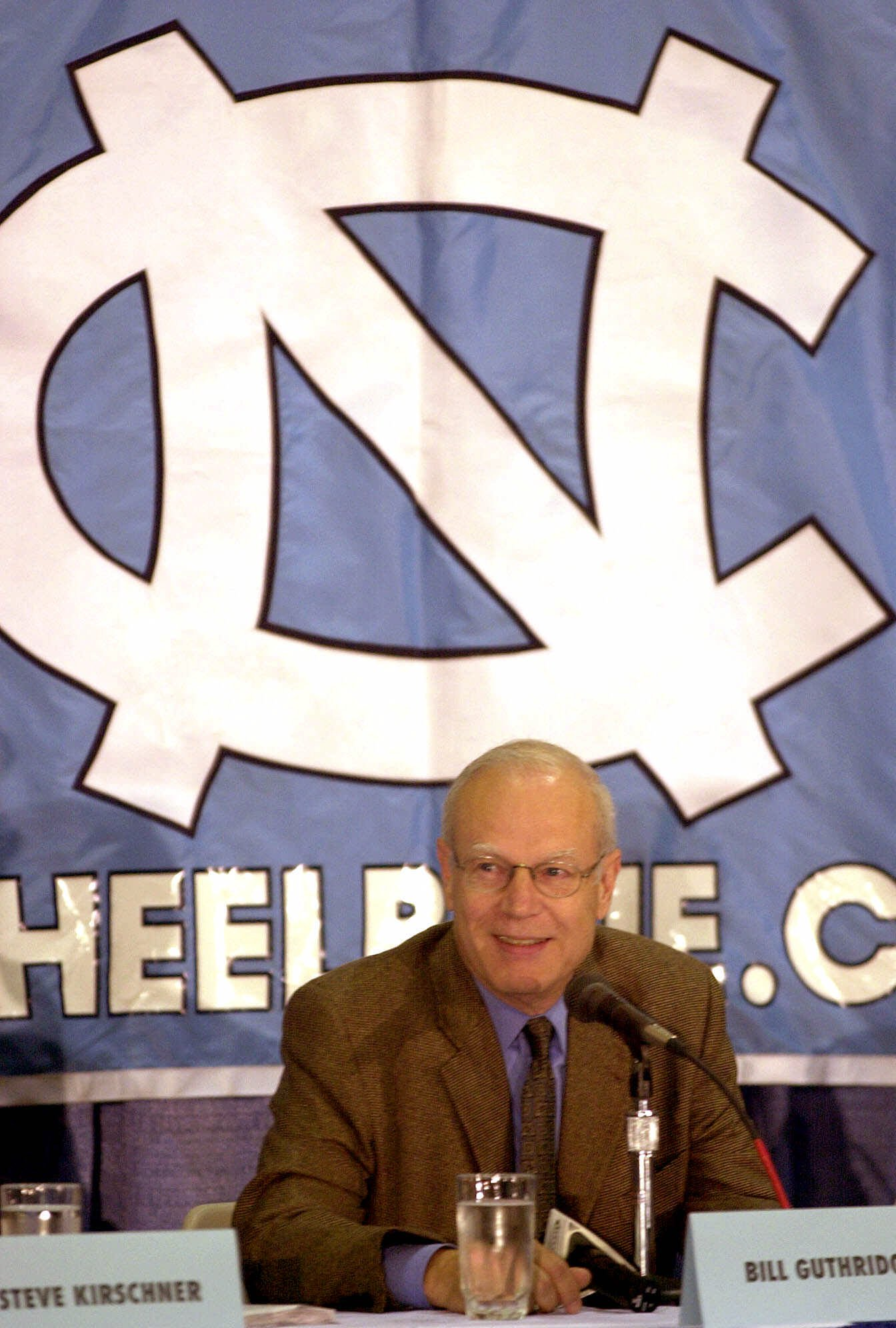North Carolina basketball coach Bill Guthridge smiles as he announces his retirement during a news conference Friday, June 30, 2000, in Chapel Hill, N.C.  The 62-year-old coach spent 30 seasons as an assistant to Dean Smith, the winningest coach in colleg