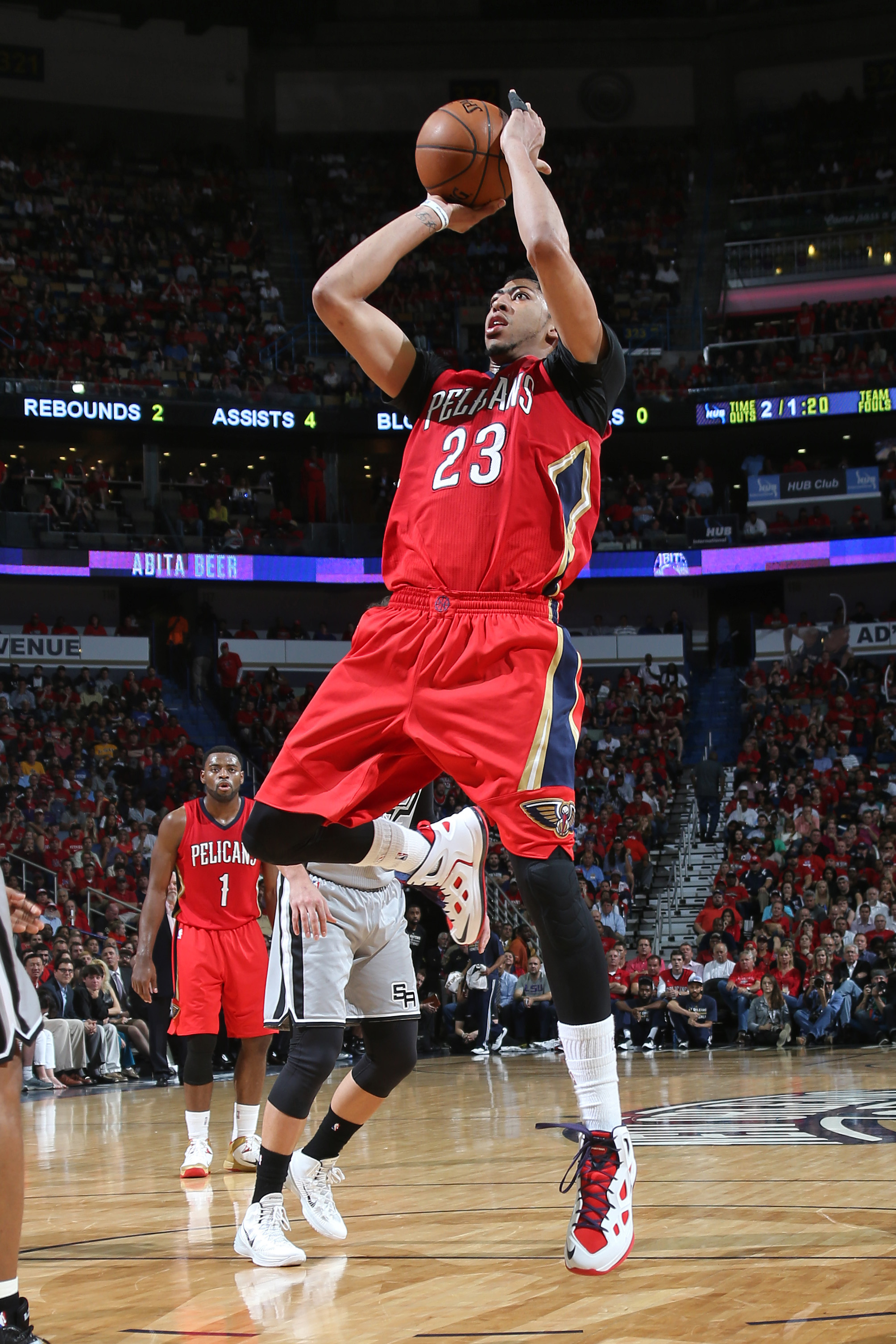 NEW ORLEANS, LA - APRIL 15: Anthony Davis #23 of the New Orleans Pelicans shoots against the San Antonio Spurs during the game on April 15, 2015 at Smoothie King Center in New Orleans, Louisiana. (Photo by Layne Murdoch Jr,/NBAE via Getty Images)
