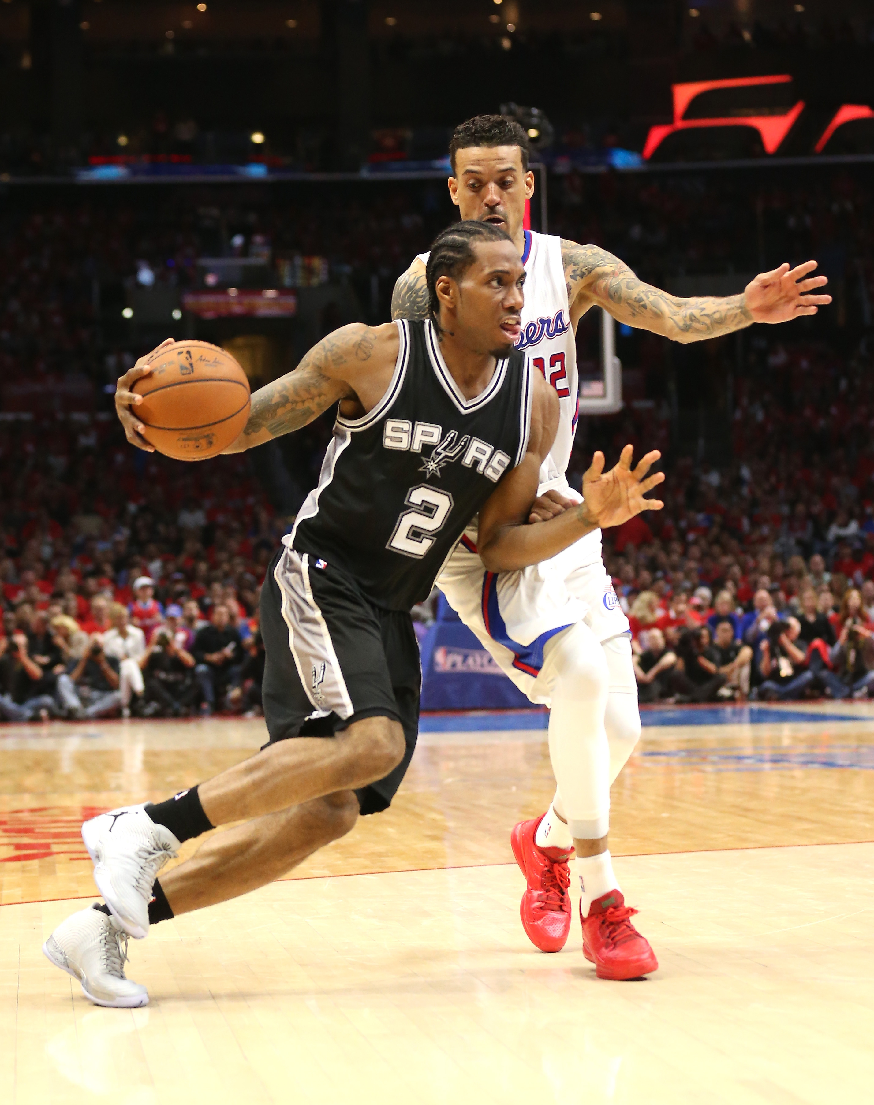 LOS ANGELES, CA - APRIL 19:  Kawhi Leonard #2 of the San Antonio Spurs drives around Matt Barnes #22 of the Los Angeles Clippers during Game One of the Western Conference quarterfinals of the 2015 NBA Playoffs at Staples Center on April 19, 2015 in Los An