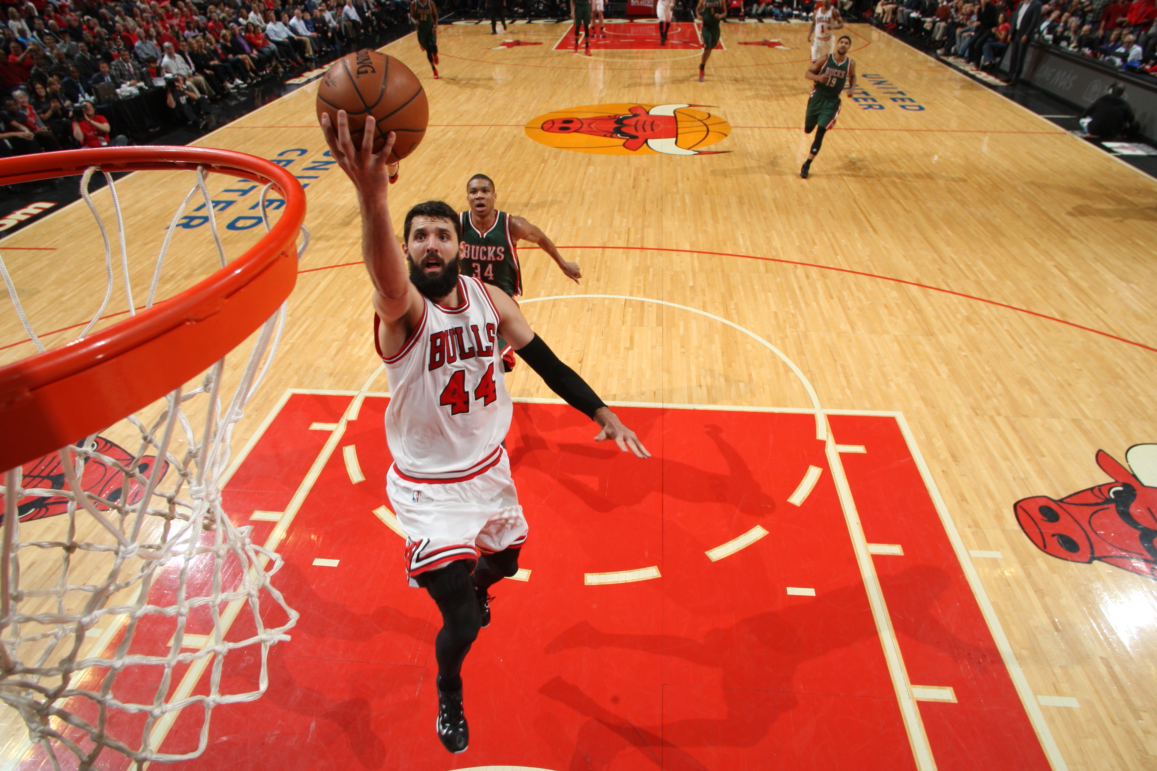 CHICAGO, IL - APRIL 20:  Nikola Mirotic #44 of the Chicago Bulls goes to the basket against the Milwaukee Bucks in Game Two of the Eastern Conference Quarterfinals during the NBA Playoffs on April 20, 2015 at the United Center in Chicago, Illinois. (Photo