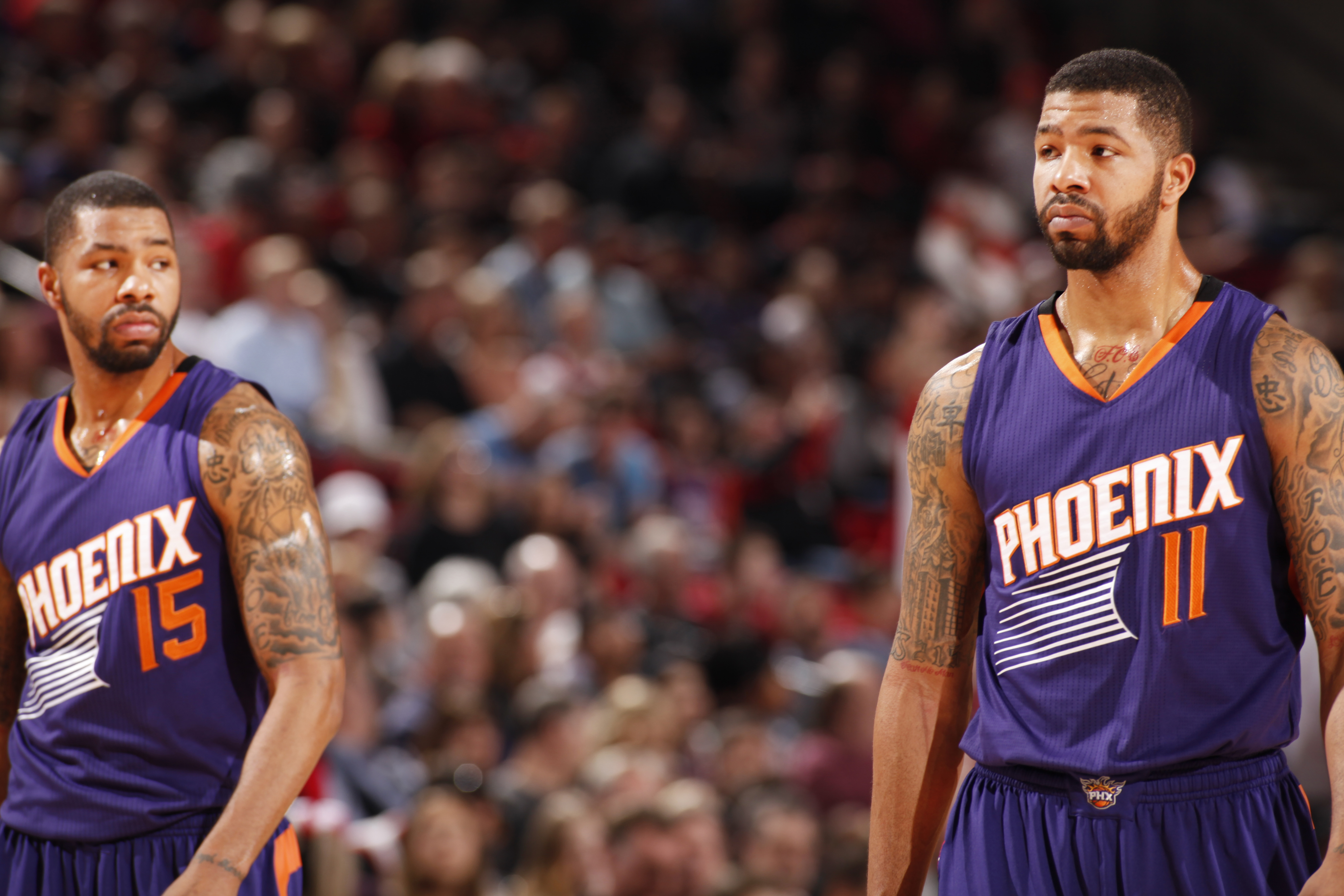PORTLAND, OR - MARCH 30: Marcus Morris #15 and Markieff Morris #11 of the Phoenix Suns during the game against the Portland Trail Blazers on March 30, 2015 at Moda Center in Portland, Oregon. (Photo by Cameron Browne/NBAE via Getty Images)