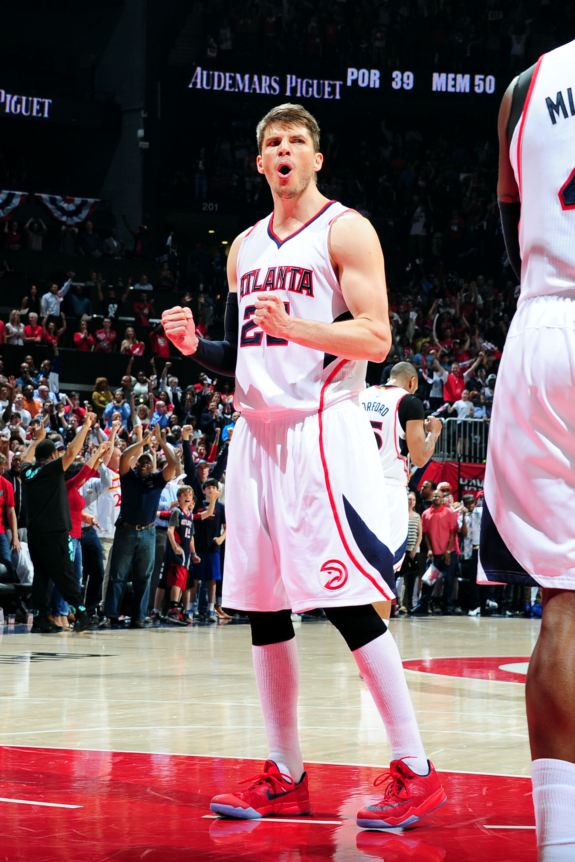 ATLANTA, GA - APRIl 22: Kyle Korver #26 of the Atlanta Hawks celebrates during a game against the Brooklyn Nets in Game Two of the Eastern Conference Quarterfinals of the NBA Playoffs on April 22, 2015 at Philips Arena in Atlanta, Georgia. (Photo by Scott