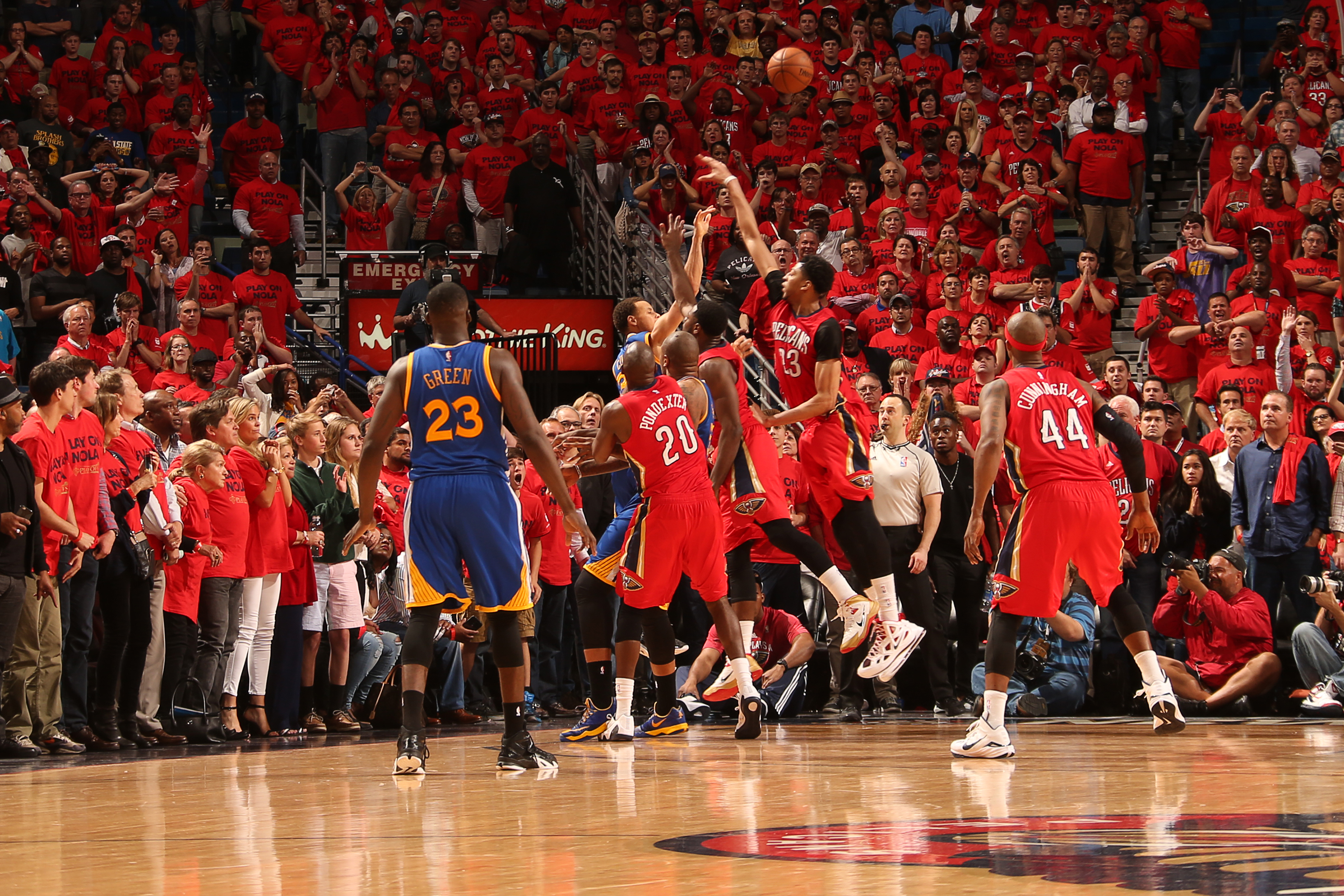 NEW ORLEANS, LA - APRIL 23: Stephen Curry #30 of the Golden State Warriors makes a three point shot against the New Orleans Pelicans to take them into overtime in Game Three of the Western Conference Quarterfinals during the NBA Playoffs on April 23, 2015