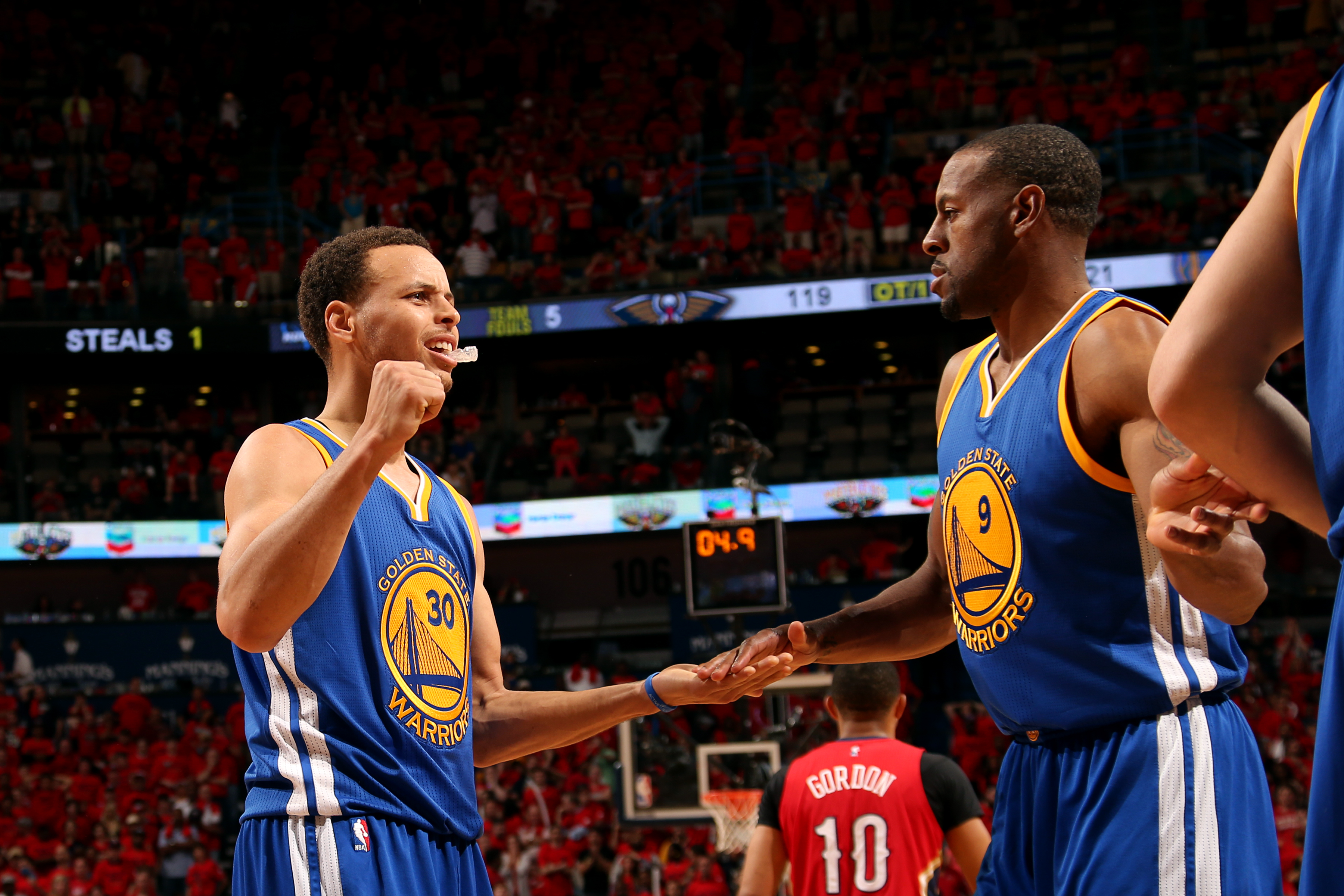 NEW ORLEANS, LA - APRIL 23: Stephen Curry #30 and Andre Iguodala #9 of the Golden State Warriors celebrate during a game against the New Orleans Pelicans in Game Three of the Western Conference Quarterfinals during the NBA Playoffs on April 23, 2015 at Sm