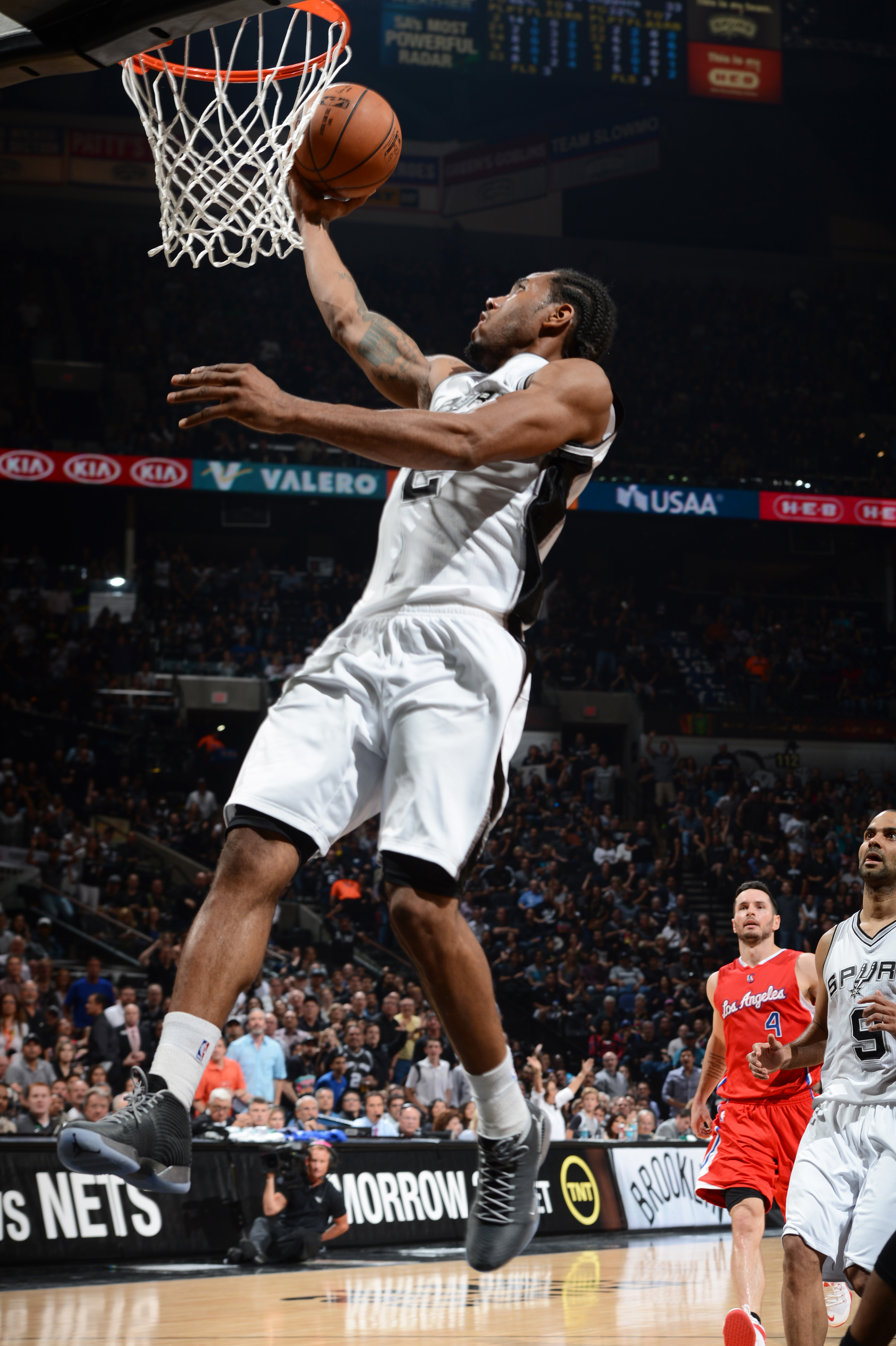 SAN ANTONIO - APRIL 24: Kawhi Leonard #2 of the San Antonio Spurs goes up for a shot against the Los Angeles Clippers during Game Three of the Western Conference Quarterfinals at the AT&T Center on April 24, 2015 in San Antonio, Texas.