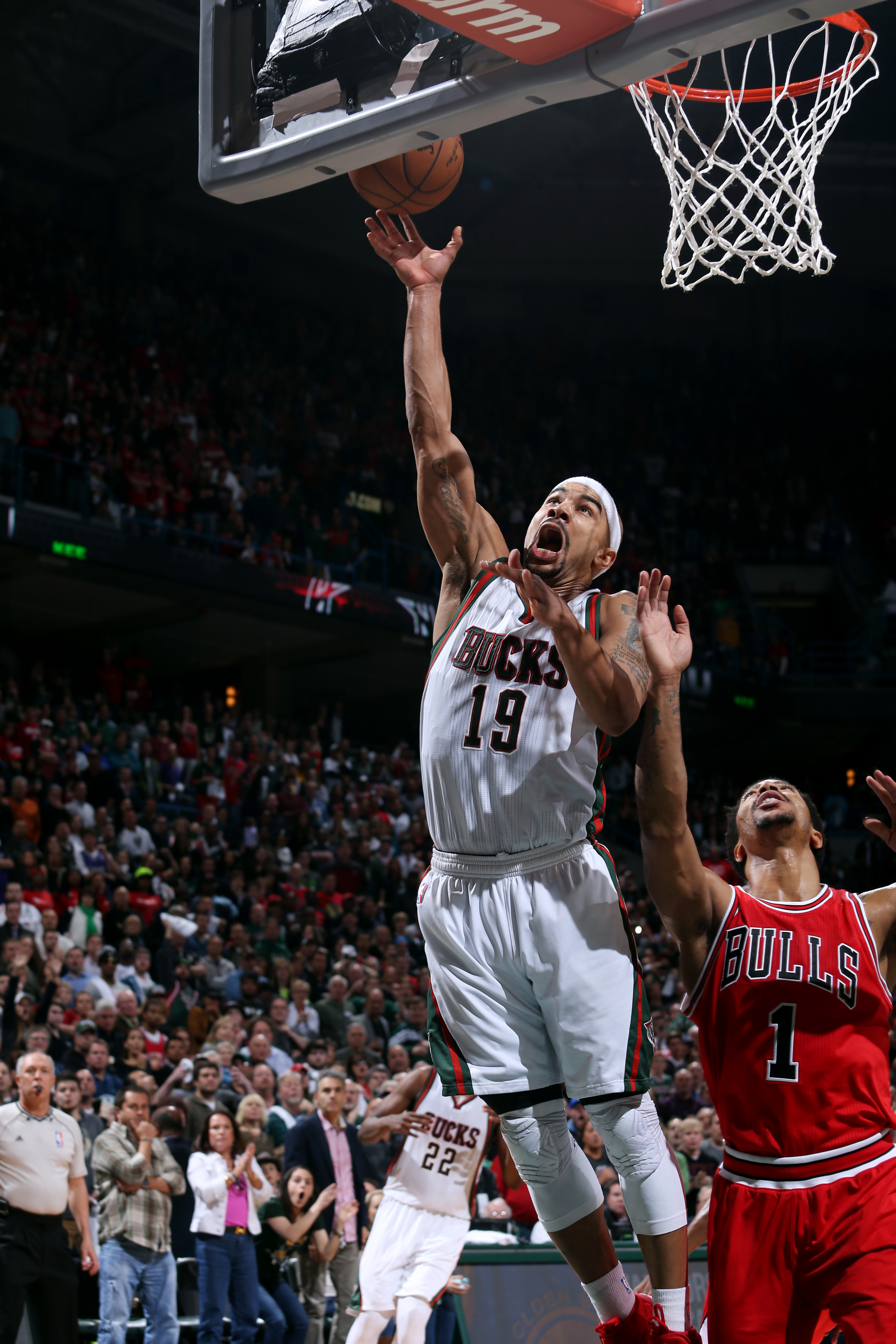MILWAUKEE, WI - APRIL 25: Jerryd Bayless #19 of the Milwaukee Bucks shoots the game winning layup against the Chicago Bulls in Game Four of the Eastern Conference Quarterfinals during the 2015 NBA Playoffs on April 25, 2015 at the BMO Harris Bradley Cente