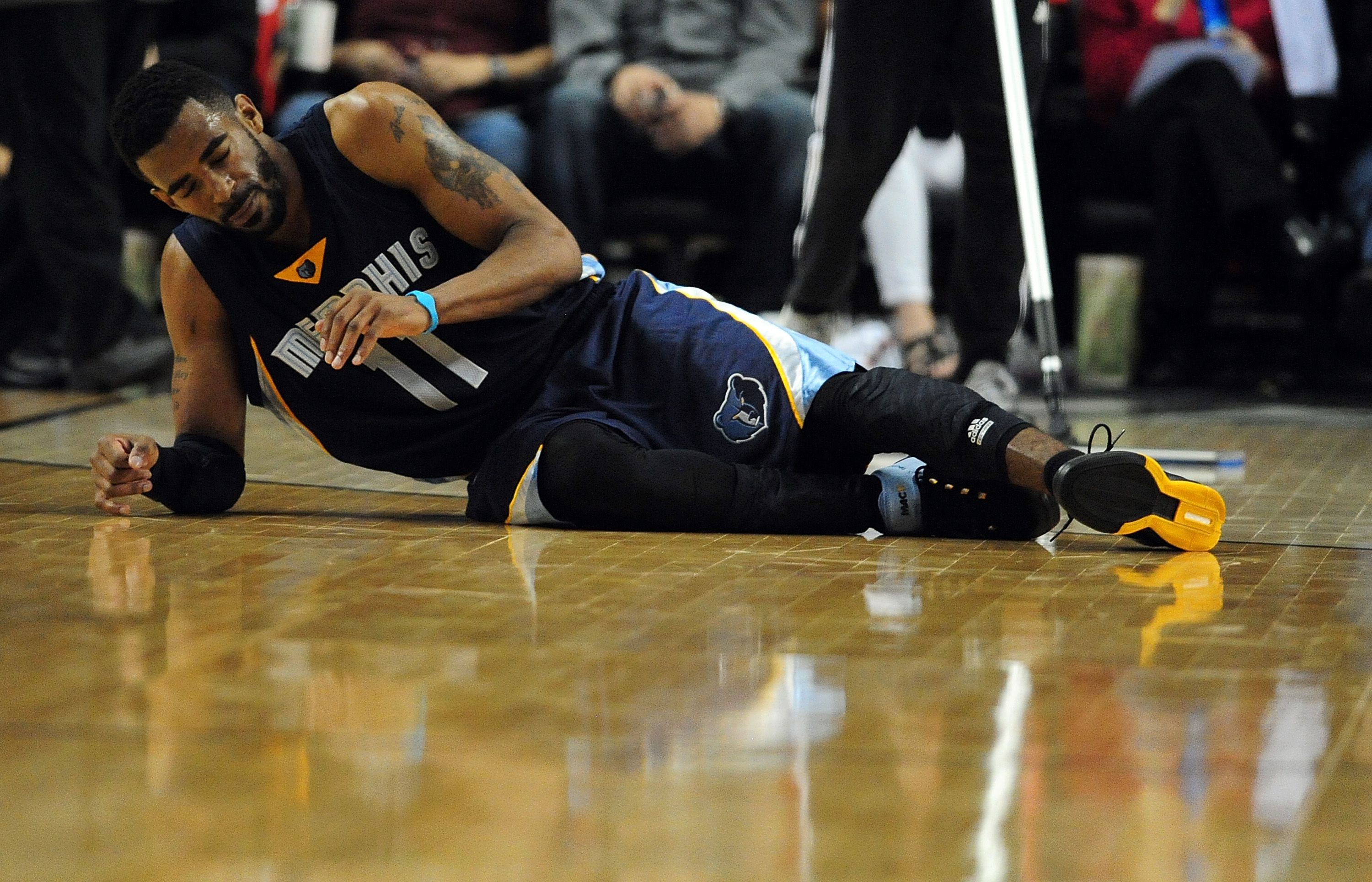 PORTLAND, OR - APRIL 25: Mike Conley #11 of the Memphis Grizzlies rolls over on the court after being injured during the third quarter in Game Three of the Western Conference quarterfinals against the Portland Trail Blazers during the 2015 NBA Playoffs at
