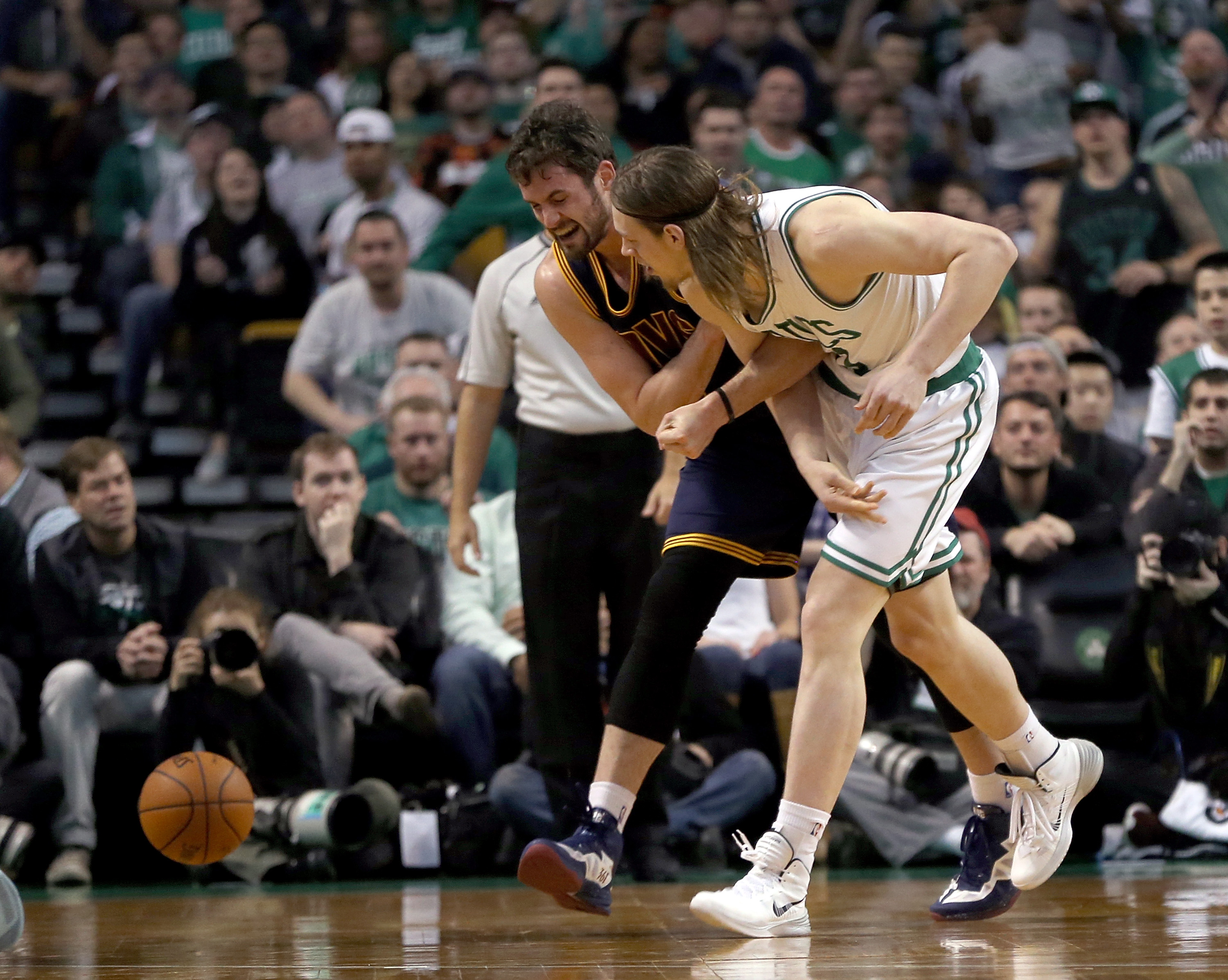 BOSTON, MA - APRIL 26: Kevin Love #0 of the Cleveland Cavaliers injures his shoulder as he chases a loose ball against Kelly Olynyk #41 of the Boston Celtics in the first half in Game Four during the first round of the 2015 NBA Playoffs on April 26, 2015