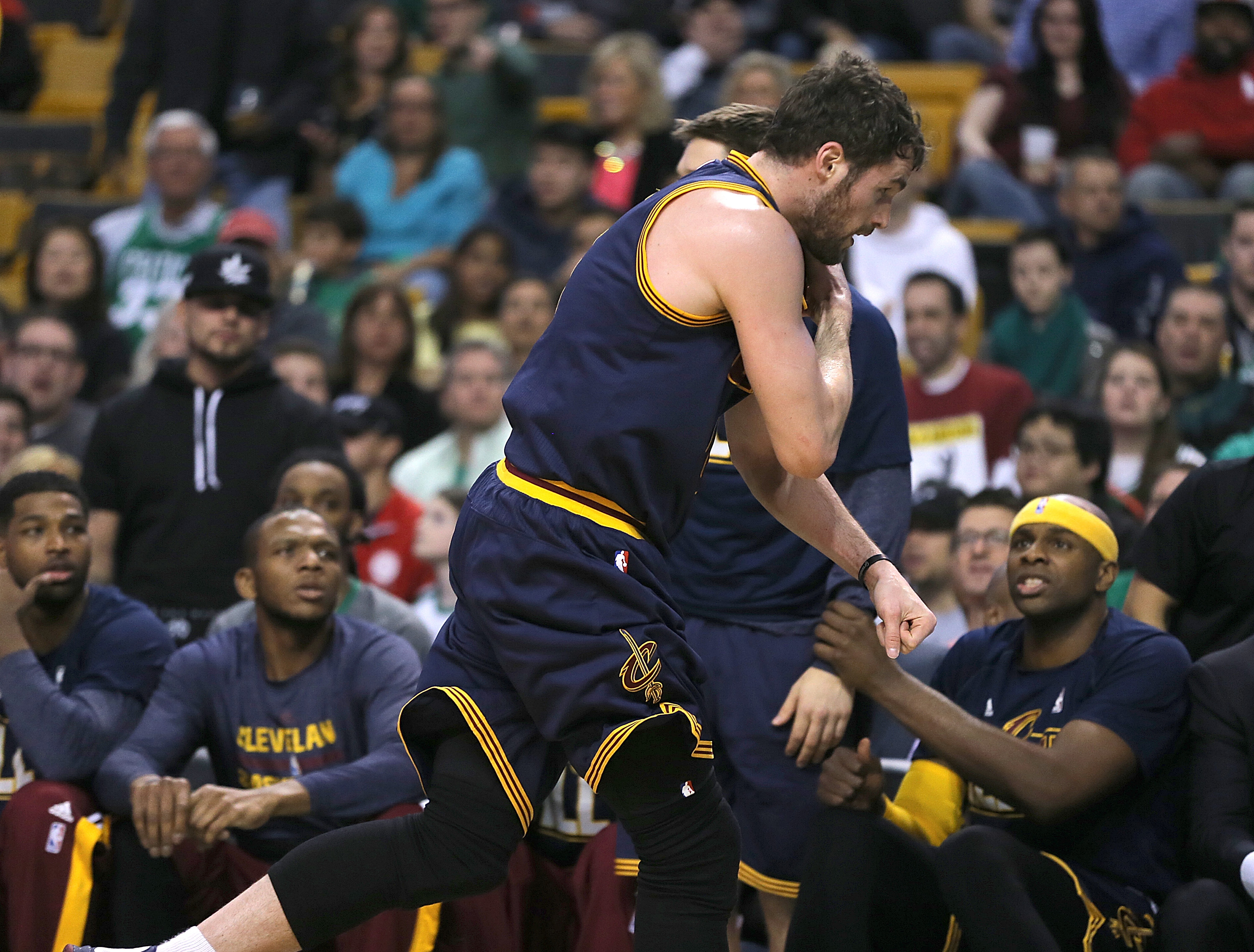 BOSTON, MA - APRIL 26: Kevin Love #0 of the Cleveland Cavaliers runs by teammates off of the court after an injury against the Boston Celtics in the first quarter in Game Four during the first round of the 2015 NBA Playoffs on April 26, 2015 at TD Garden