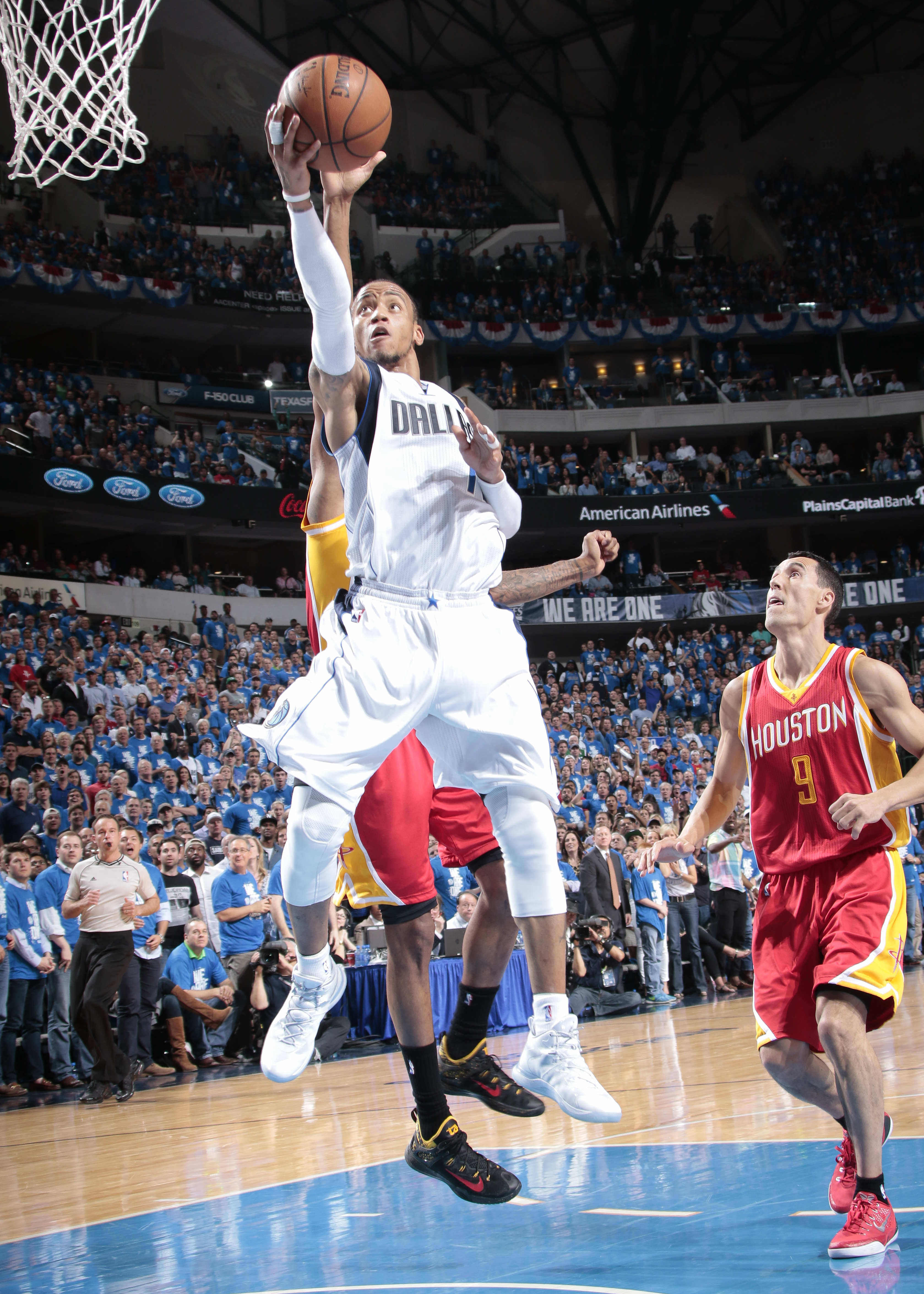 DALLAS, TX - APRIL 26: Monta Ellis #11 of the Dallas Mavericks goes in for the lay up against the Houston Rockets during Game Four of the Western Conference Quarterfinals of the 2015 NBA Playoffs on April 26, 2015 at the American Airlines Center in Dallas