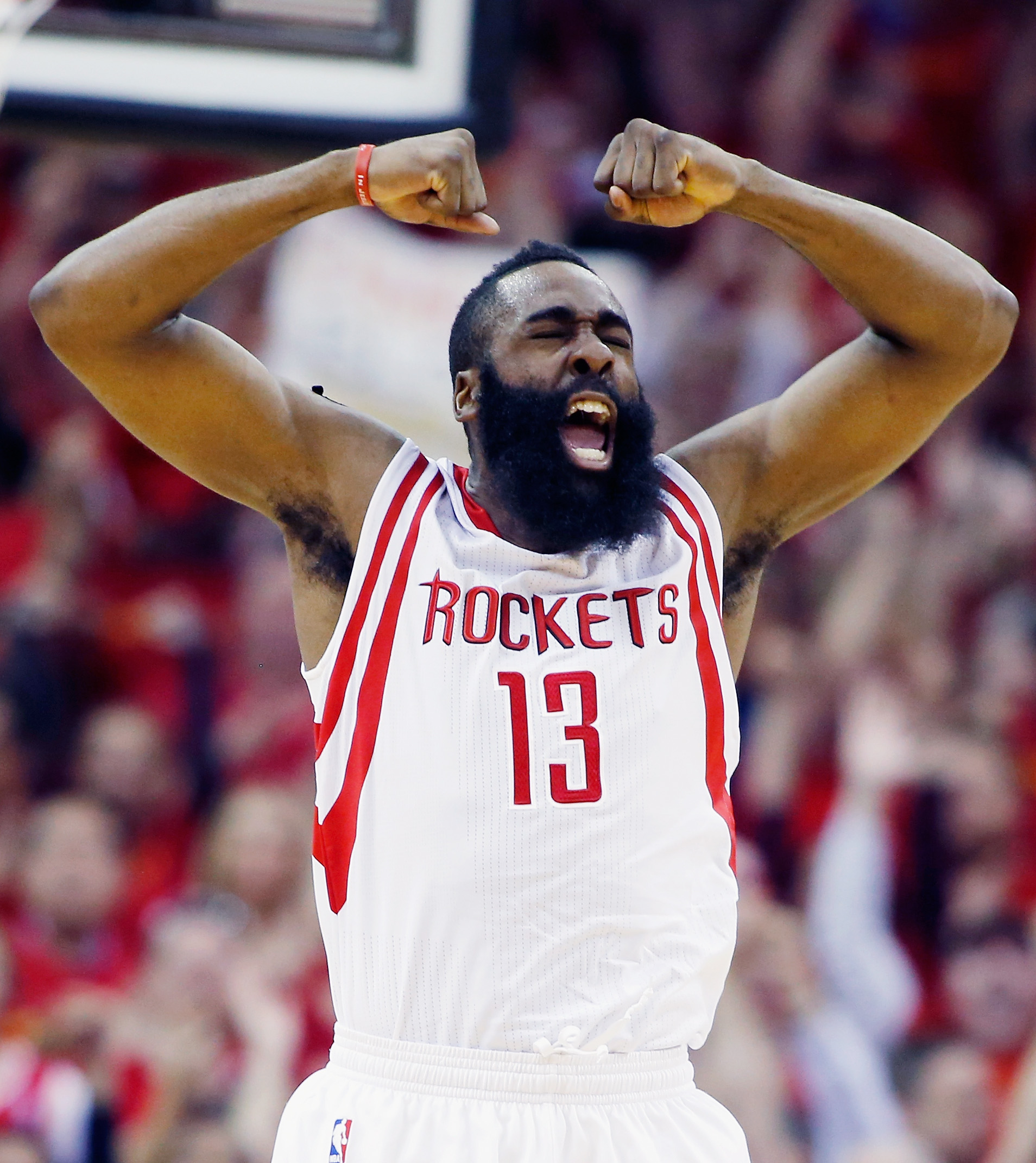 HOUSTON, TX - APRIL 28:  James Harden #13 of the Houston Rockets celebrates a late basket against the Dallas Mavericks during Game Five in the Western Conference Quarterfinals of the 2015 NBA Playoffs on April 28, 2015 at the Toyota Center in Houston, Tex