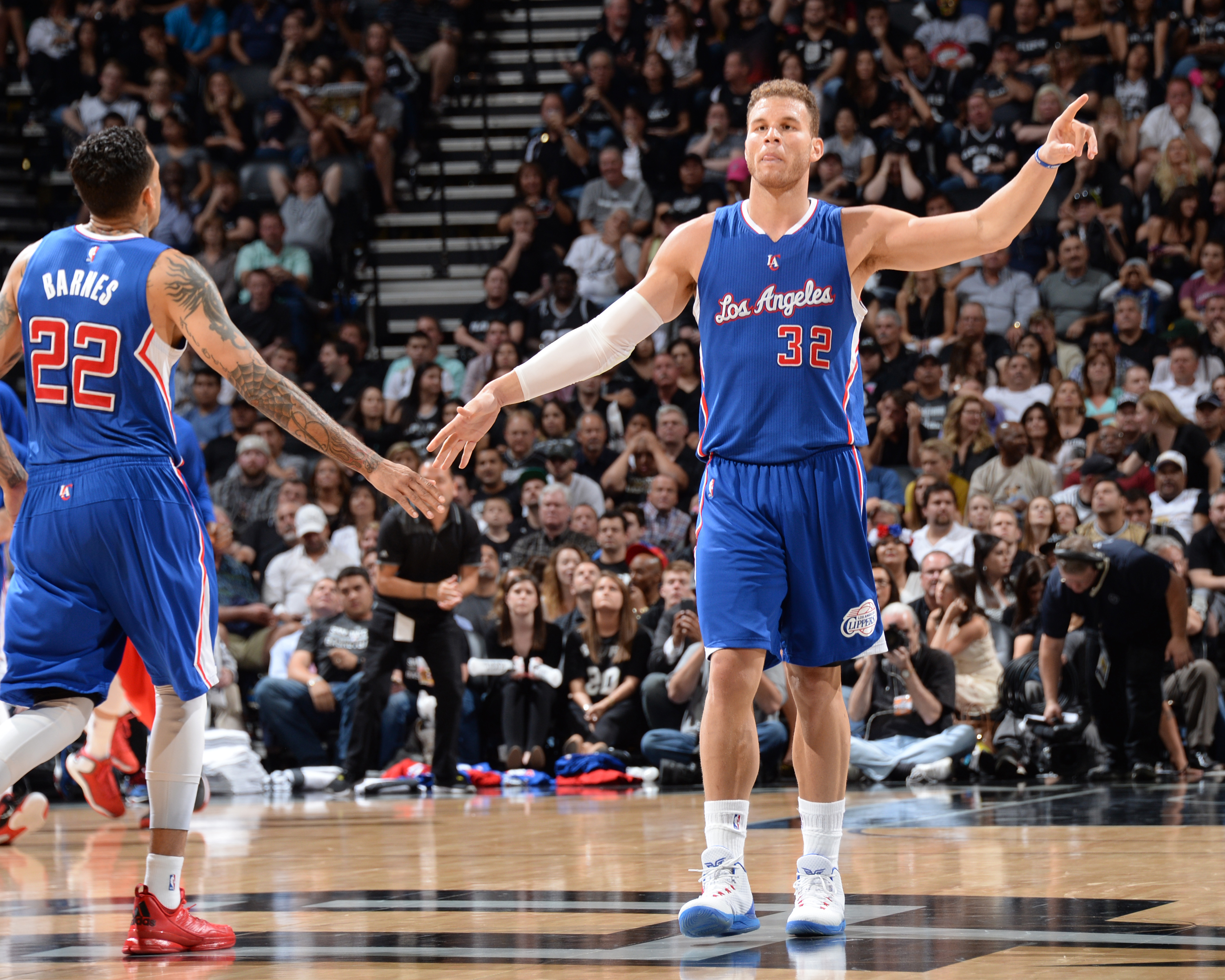 SAN ANTONIO, TEXAS - April 30: Blake Griffin #32 high fives teammates Matt Barnes #22 of the Los Angeles Clippers during Game Six of the Western Conference Quarterfinals against the San Antonio Spurs during the NBA Playoffs on April 30, 2015 at Barclays C