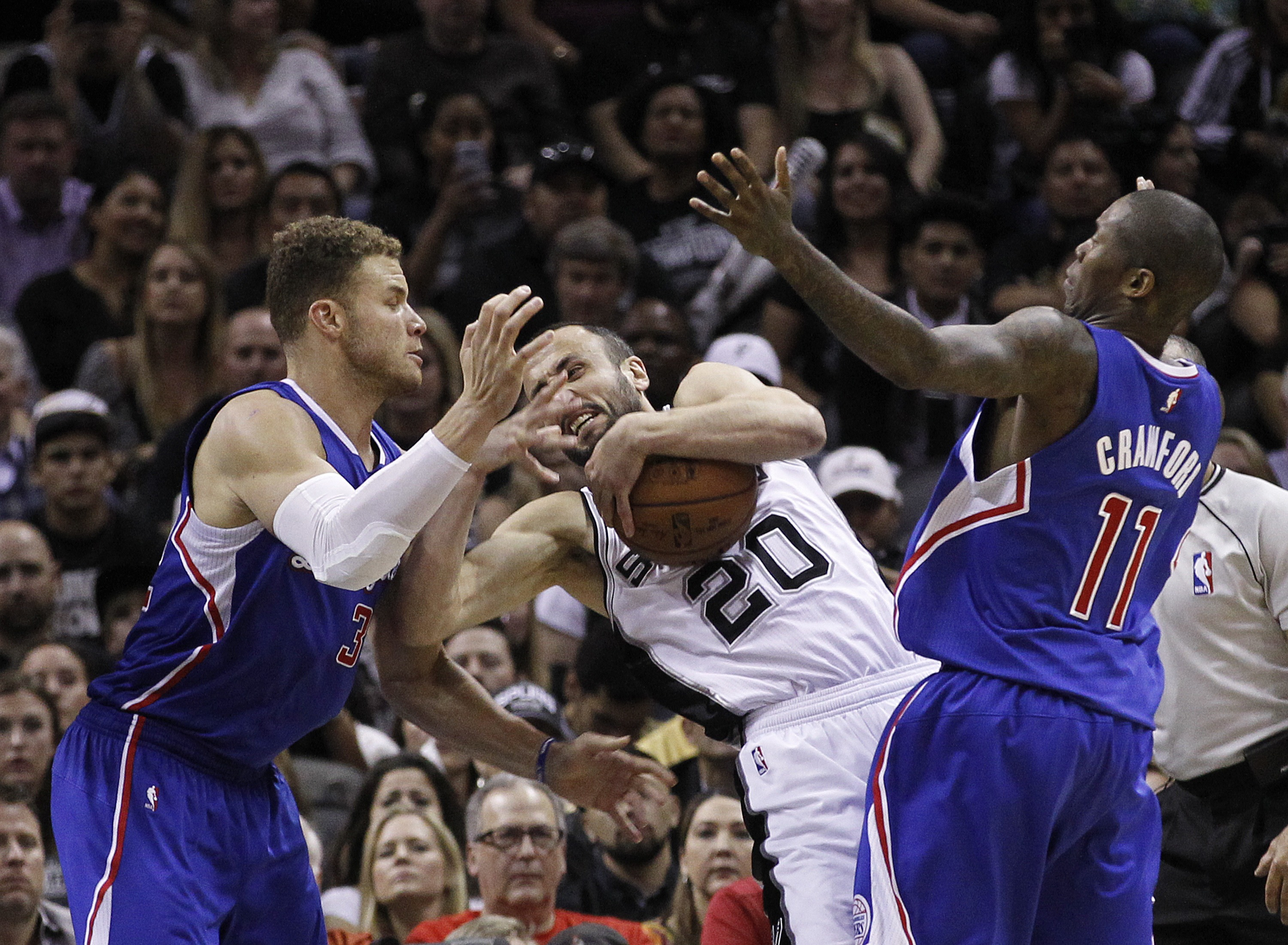 SAN ANTONIO, TX - APRIL 30: Manu Ginobili #20 of the San Antonio Spurs fights to keep control of the ball against Blake Griffin #32 and Jamal Crawford #11 of the Los Angeles Clippers during Game Six of the Western Conference quarterfinals of the 2015 NBA