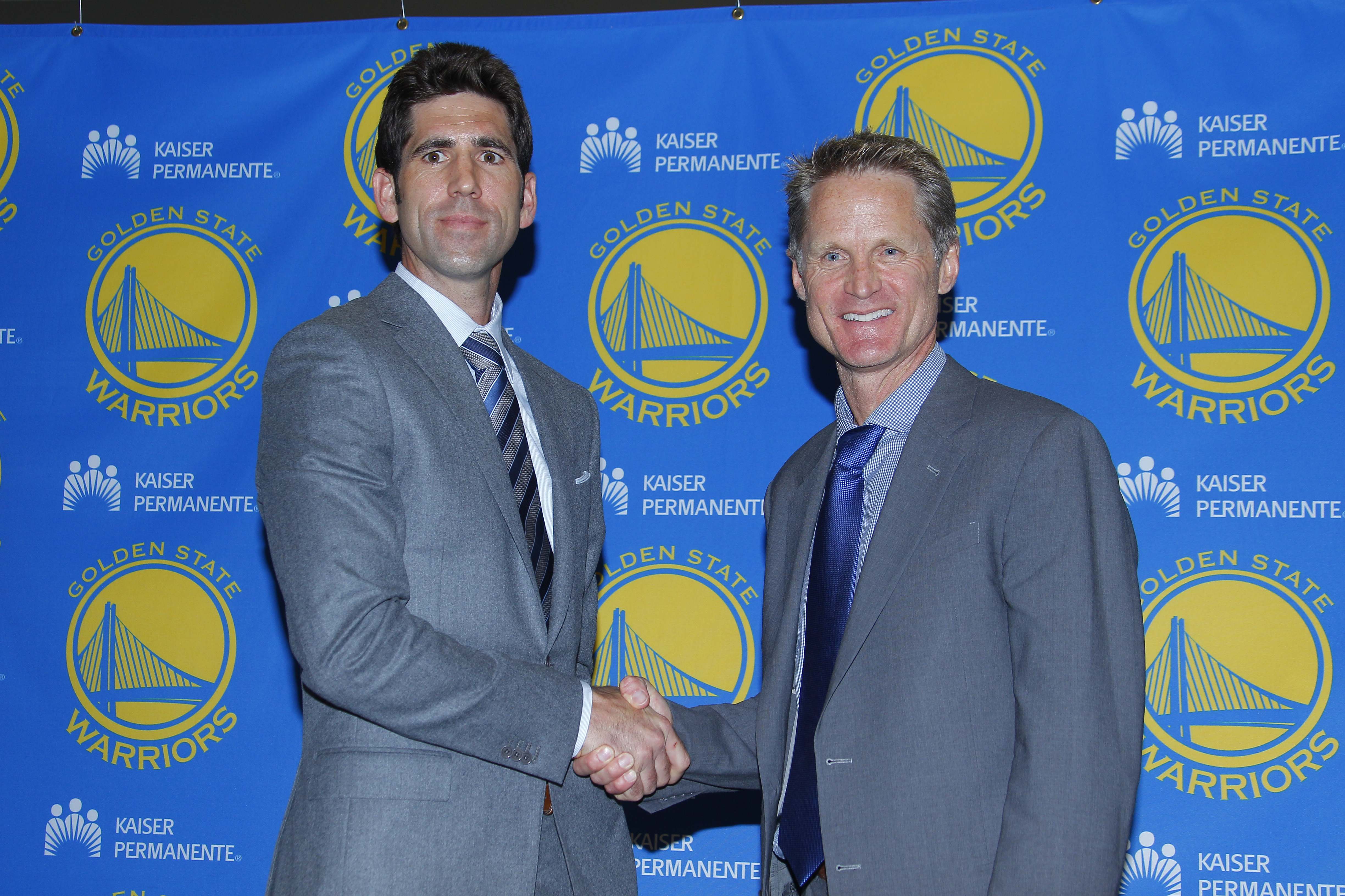OAKLAND, CA - MAY 20: Steve Kerr of the Golden State Warriors shakes hands with General Manager Bob Myers at a press conference on May 20, 2014 in Oakland, California. (Photo by Rocky Widner/NBAE via Getty Images)