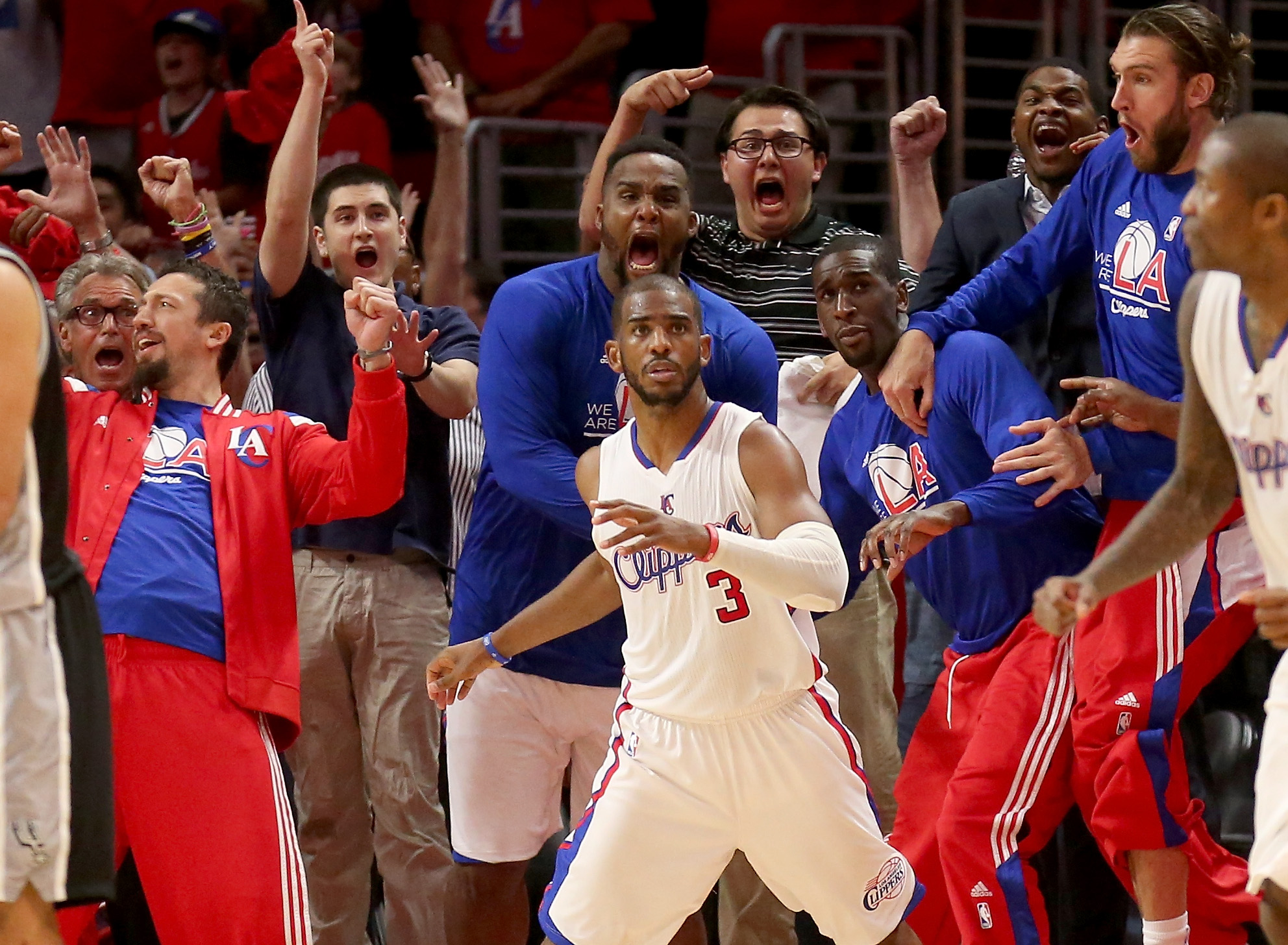 LOS ANGELES, CA - MAY 02:  Chris Paul #3 the Los Angeles Clippers and the Clippers bench react after Paul made a basket with one second remaining to give the Clippers the win against the San Antonio Spurs during Game Seven of the Western Conference quarte