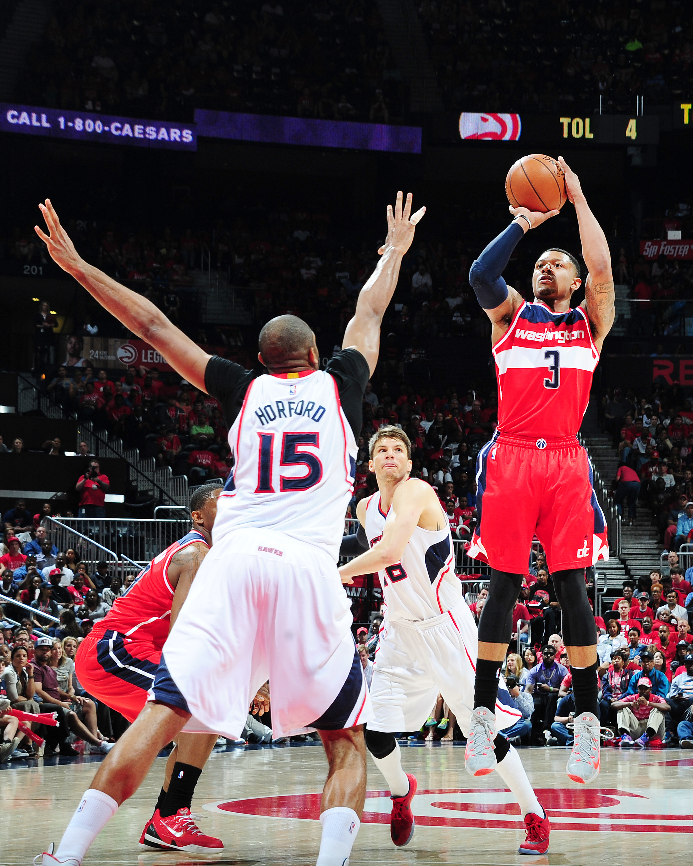 ATLANTA, GEORGIA - MAY 3: Bradley Beal #3 of the Washington Wizards shoots against the Atlanta Hawks during Game One of the Eastern Conference Semifinals during the NBA Playoffs on May 3, 2015 at Philips Center in Atlanta, Georgia.  (Photo by Scott Cunnin