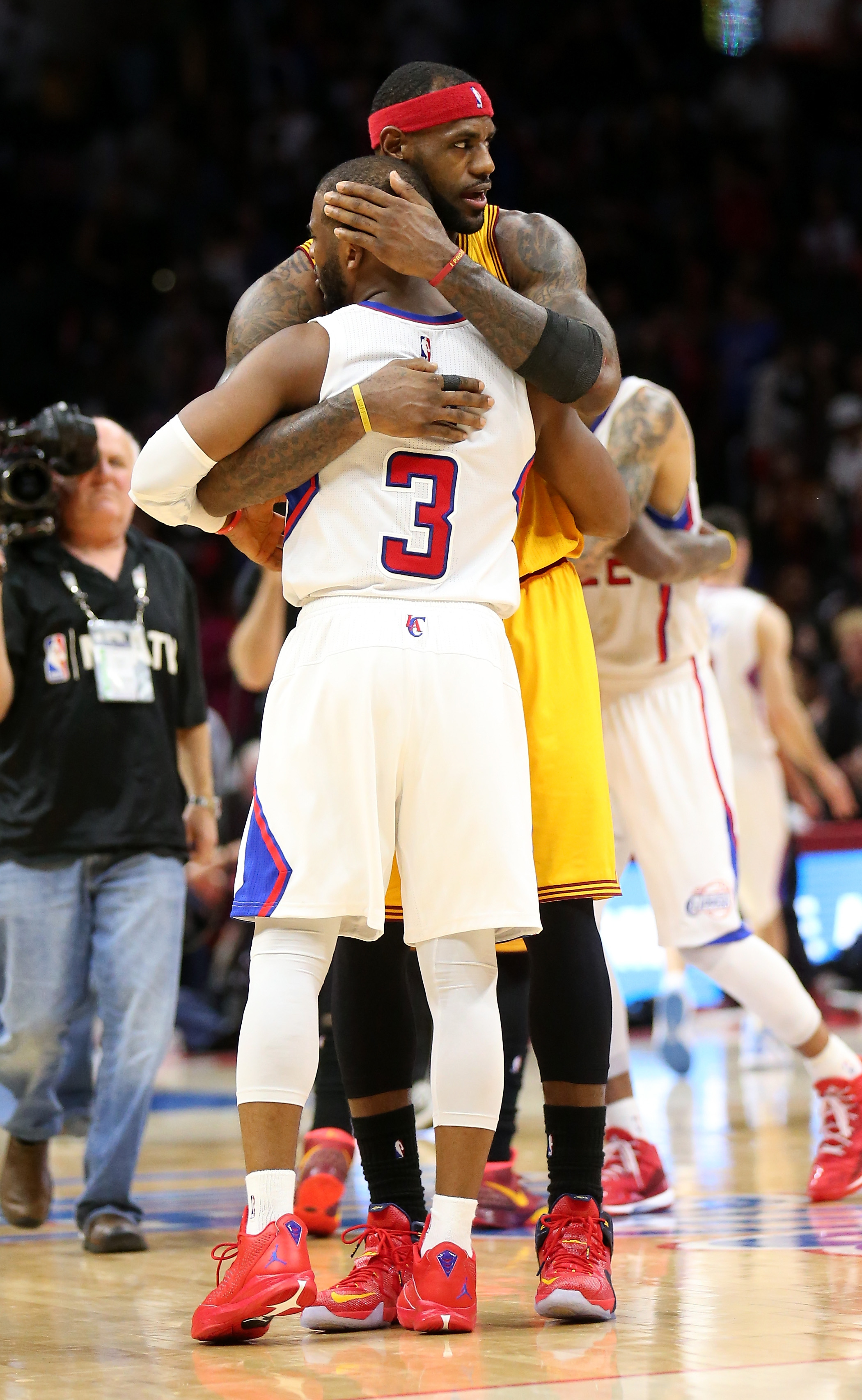 LOS ANGELES, CA - JANUARY 16:  LeBron James #23 of the Cleveland Cavaliers and Chris Paul #3 of the Los Angeles Clippers embrace after the game at Staples Center on January 16, 2015 in Los Angeles, California.  The Cavaliers won 126-121.  (Photo by Stephe