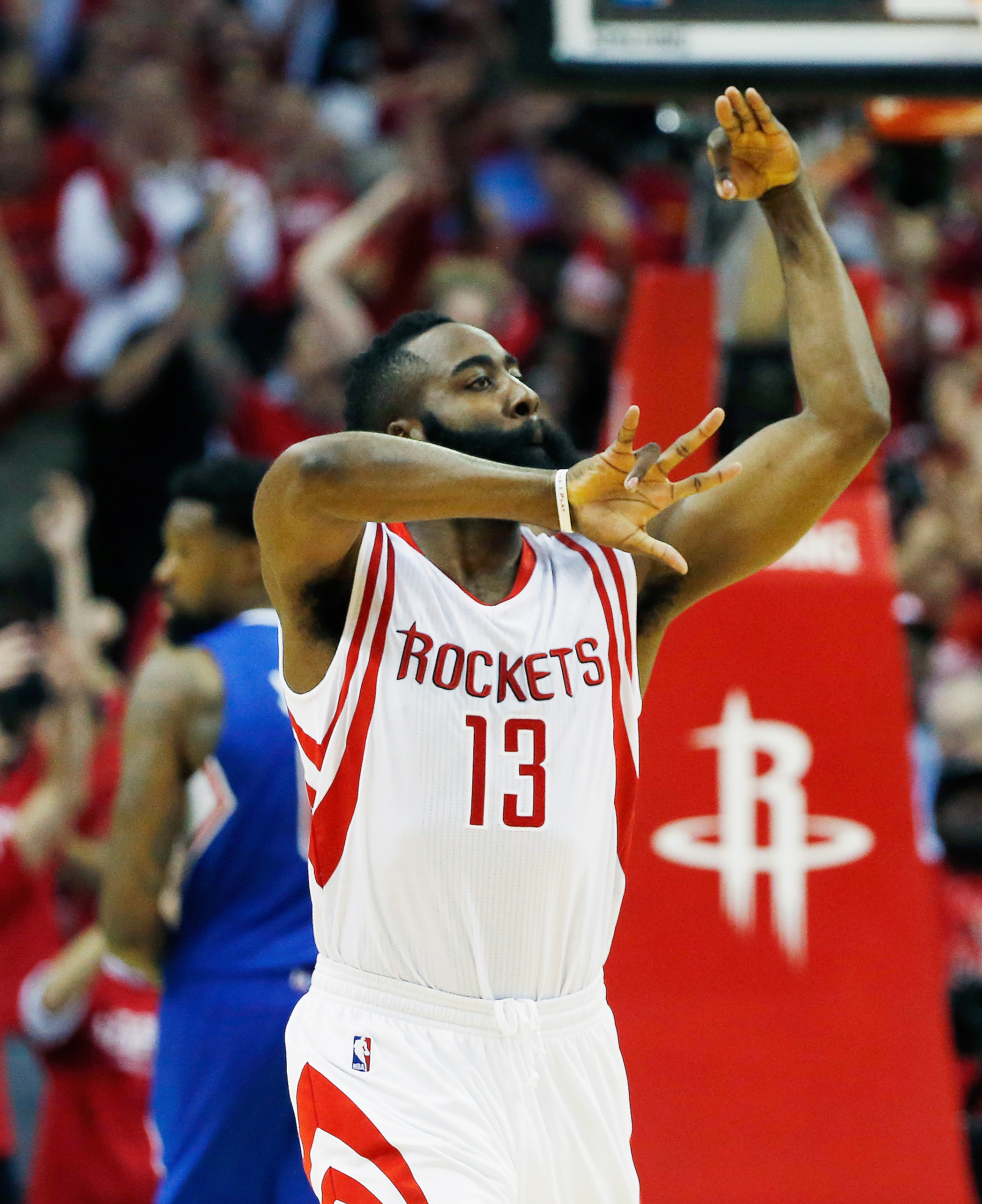 HOUSTON, TX - MAY 06:  James Harden #13 of the Houston Rockets celebrates a three point shot late in the second half against the Los Angeles Clippers during Game Two in the Western Conference Semifinals of the 2015 NBA Playoffs on May 6, 2015 at the Toyot
