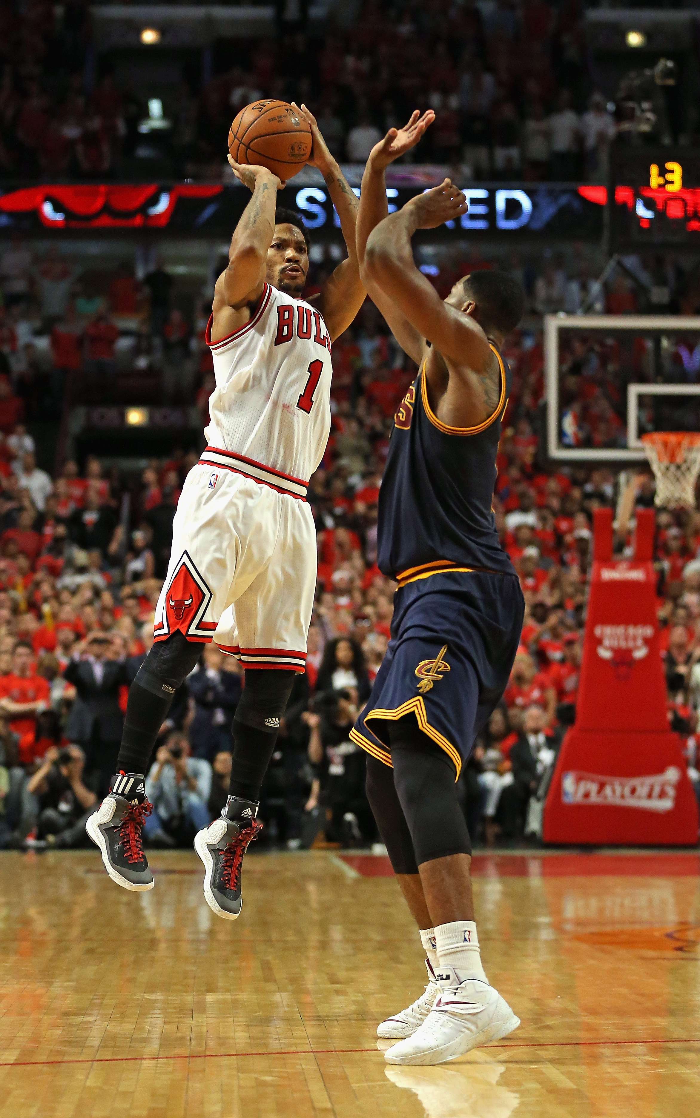 CHICAGO, IL - MAY 08: Derrick Rose #1 of the Chicago Bulls takes the game-winning three-point shot over Tristan Thompson #13 of the Cleveland Cavaliers in Game Three of the Eastern Conference Semifinals of the 2015 NBA Playoffs at the United Center on May