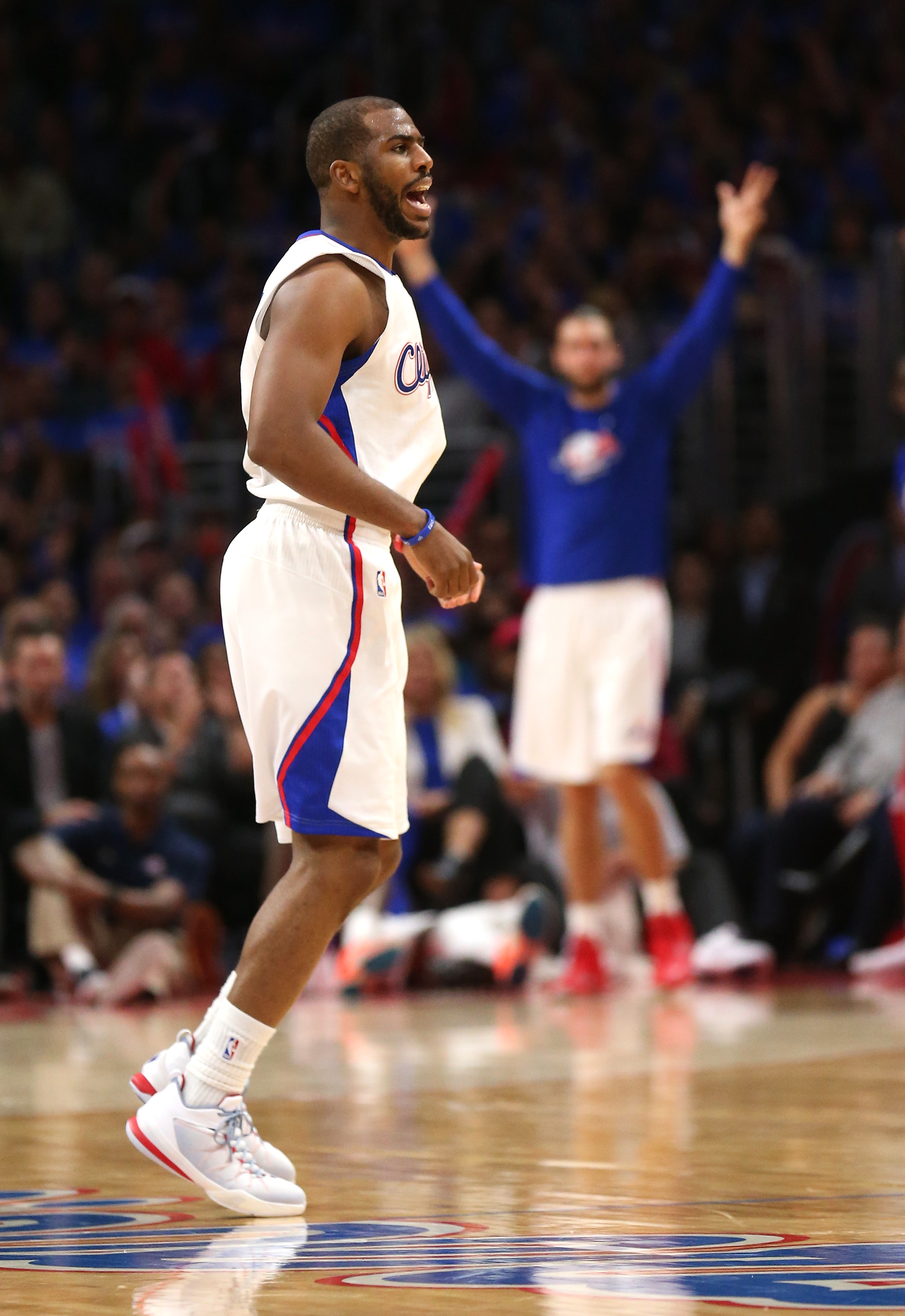 LOS ANGELES, CA - MAY 08: Chris Paul #3 of the Los Angeles Clippers reacts ater making a three point basket against the Houston Rockets during Game Three of the Western Conference semifinals of the 2015 NBA Playoffs at Staples Center on May 8, 2015 in Los