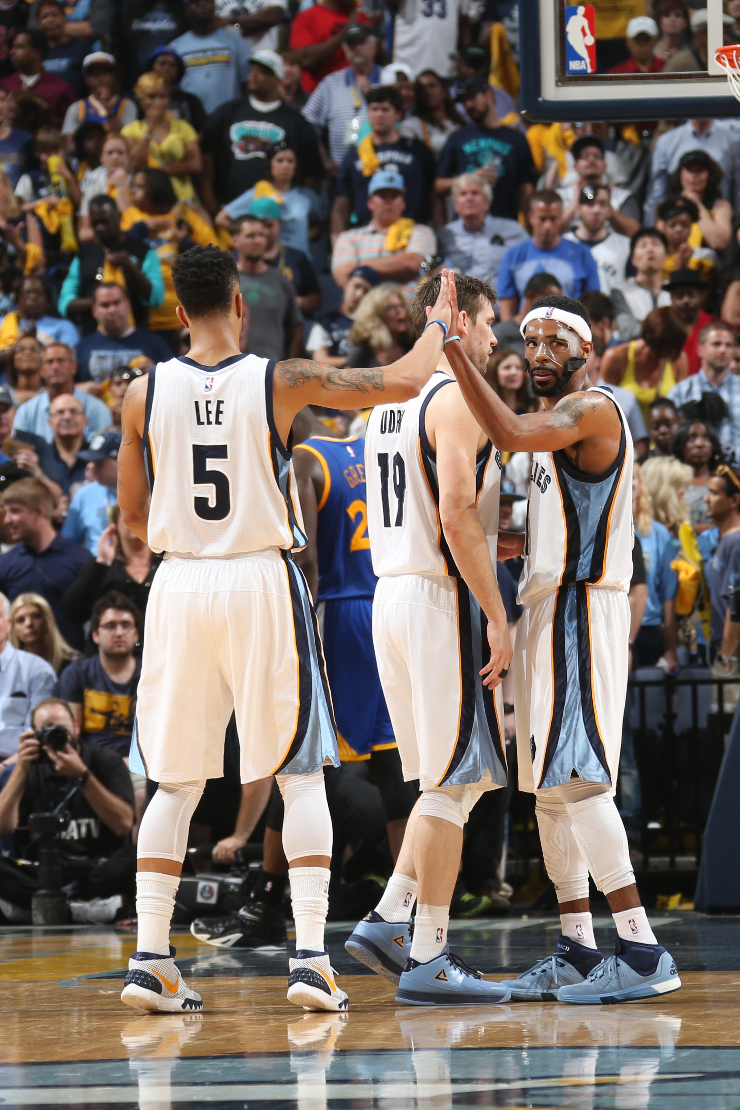 MEMPHIS, TN - MAY 9: Mike Conley #11 high fives Courtney Lee #5 of the Memphis Grizzlies during Game Three of the Western Conference Semifinals against the Golden State Warriors during the NBA Playoffs on May 9, 2015 at FedExForum in Memphis, Tennessee.