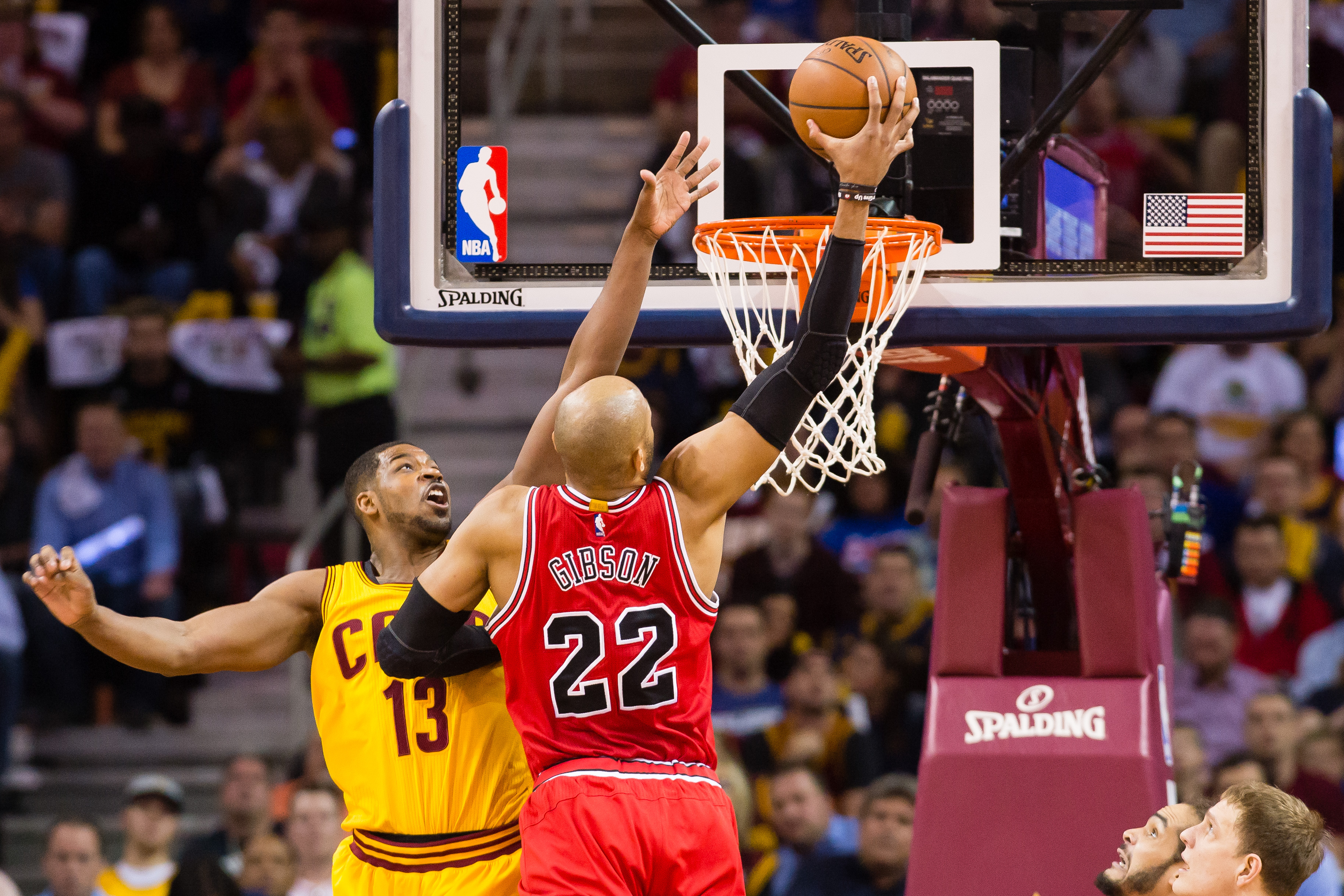 CLEVELAND, OH - MAY 12:  Tristan Thompson #13 of the Cleveland Cavaliers tries to block Taj Gibson #22 of the Chicago Bulls in the first half during Game Five in the Eastern Conference Semifinals of the 2015 NBA Playoffs 2015 at Quicken Loans Arena on May