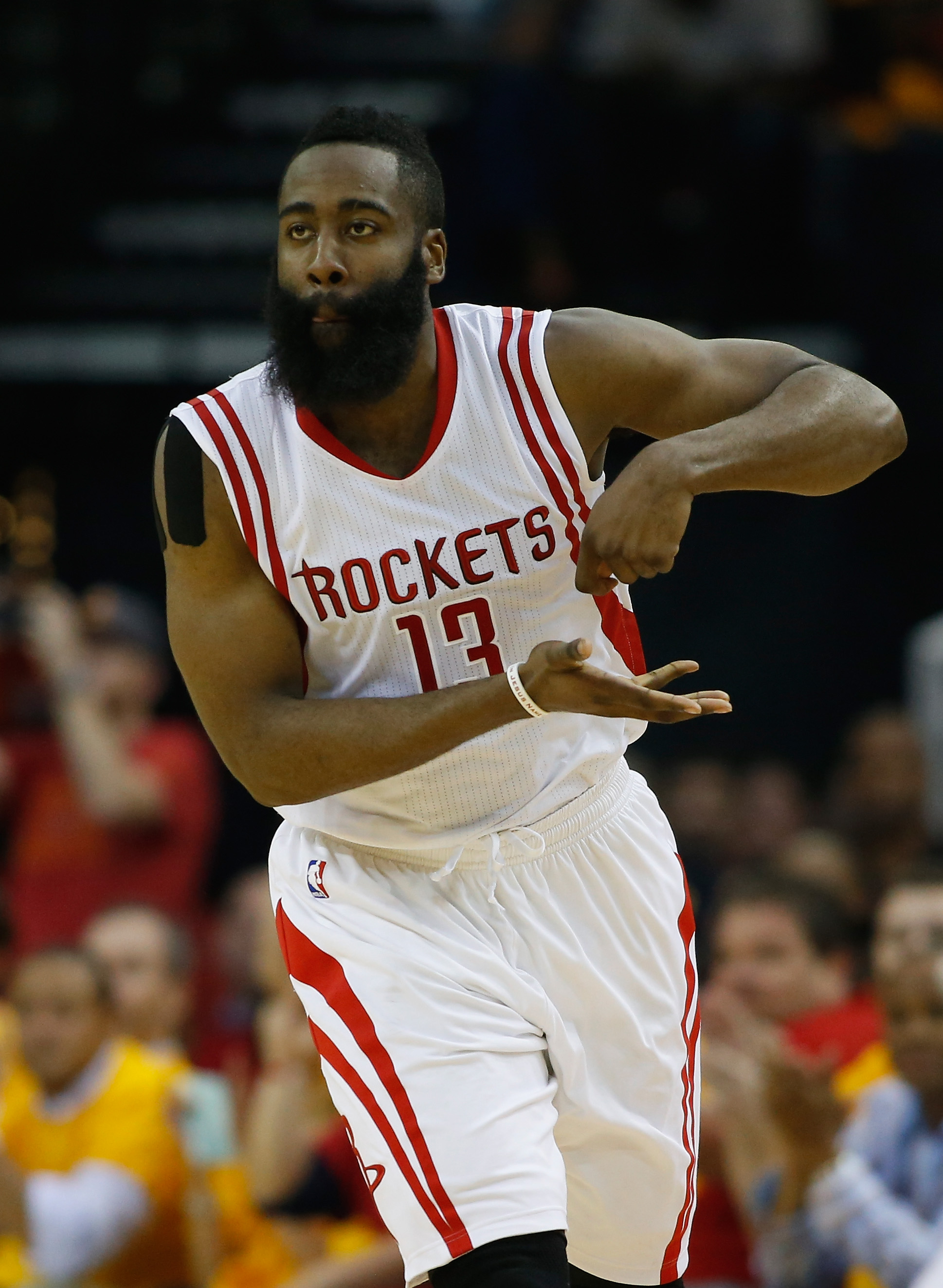 HOUSTON, TX - MAY 12:  James Harden #13 of the Houston Rockets reacts after scoring against the Los Angeles Clippers during Game Five of the Western Conference Semifinals at the Toyota Center for the 2015 NBA Playoffs on May 12, 2015 in Houston, Texas.  (