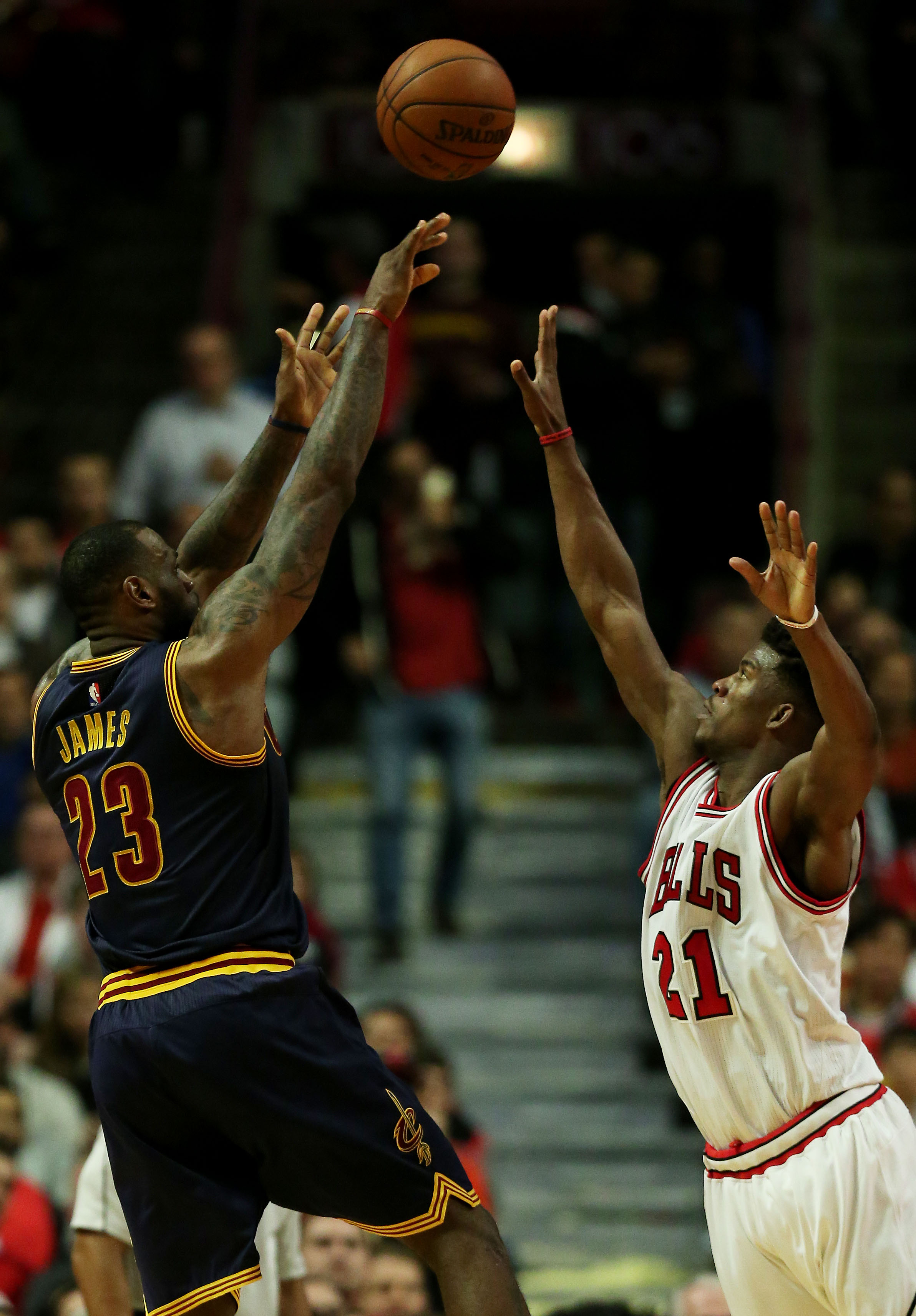 CHICAGO, IL - MAY 14:  LeBron James #23 of the Cleveland Cavaliers shoots against Jimmy Butler #21 of the Chicago Bulls in the third quarter during Game Six of the Eastern Conference Semifinals of the 2015 NBA Playoffs at United Center on May 14, 2015 in