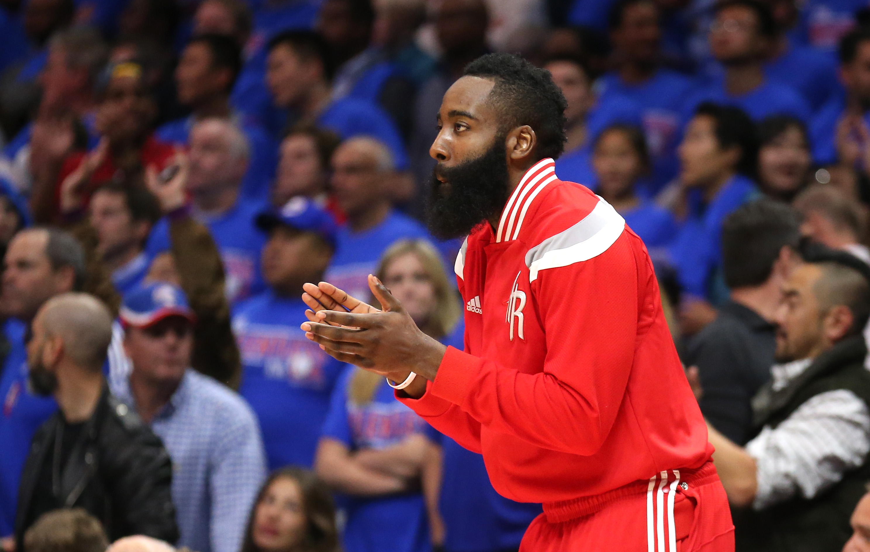 LOS ANGELES, CA - MAY 14:  James Harden #13 of the Houston Rockets cheers from the bench in the fourth quarter against the Los Angeles Clippers during Game Six of the Western Conference semifinals of the 2015 NBA Playoffs at Staples Center on May 14, 2015