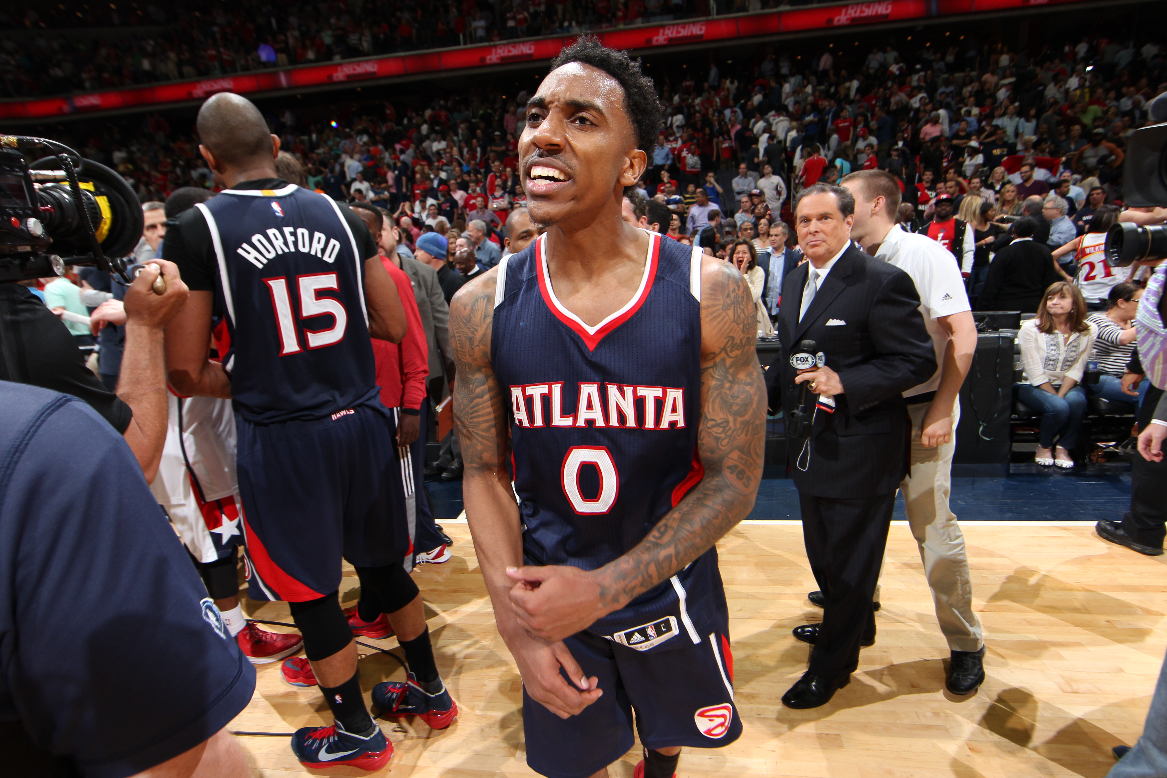 WASHINGTON, DC - MAY 15: Jeff Teague #0 of the Atlanta Hawks celebrates after the win against the Washington Wizards in Game Six of the Eastern Conference Semifinals of the 2015 NBA Playoffs at the Verizon Center on May 15, 2015 in Washington, DC. (Photo