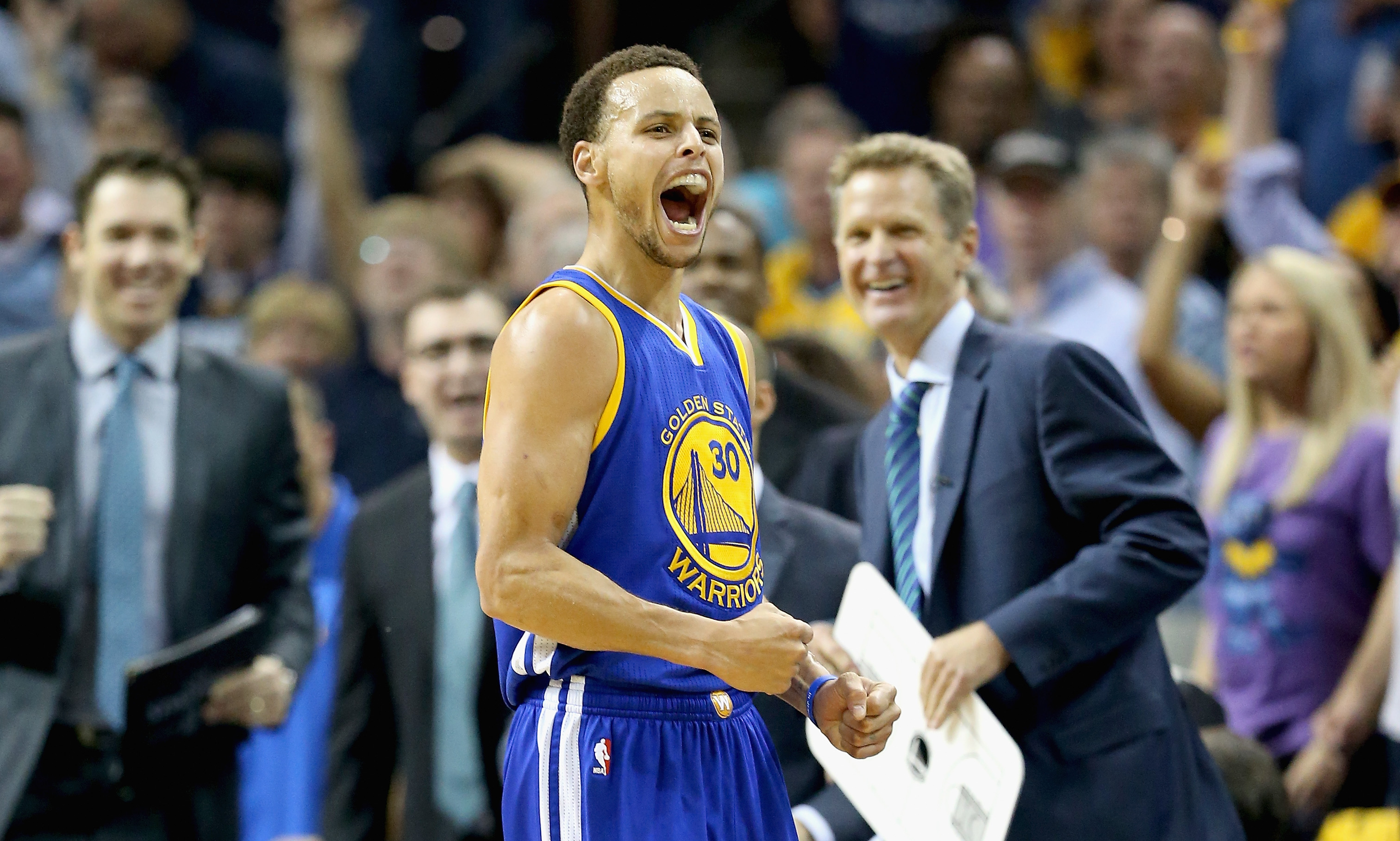 MEMPHIS, TN - MAY 15:  Stephen Curry #30 of the  Golden State Warriors celebrates after making a basket to end the third quarter against the Memphis Grizzlies during Game six of the Western Conference Semifinals of the 2015 NBA Playoffs at FedExForum on M