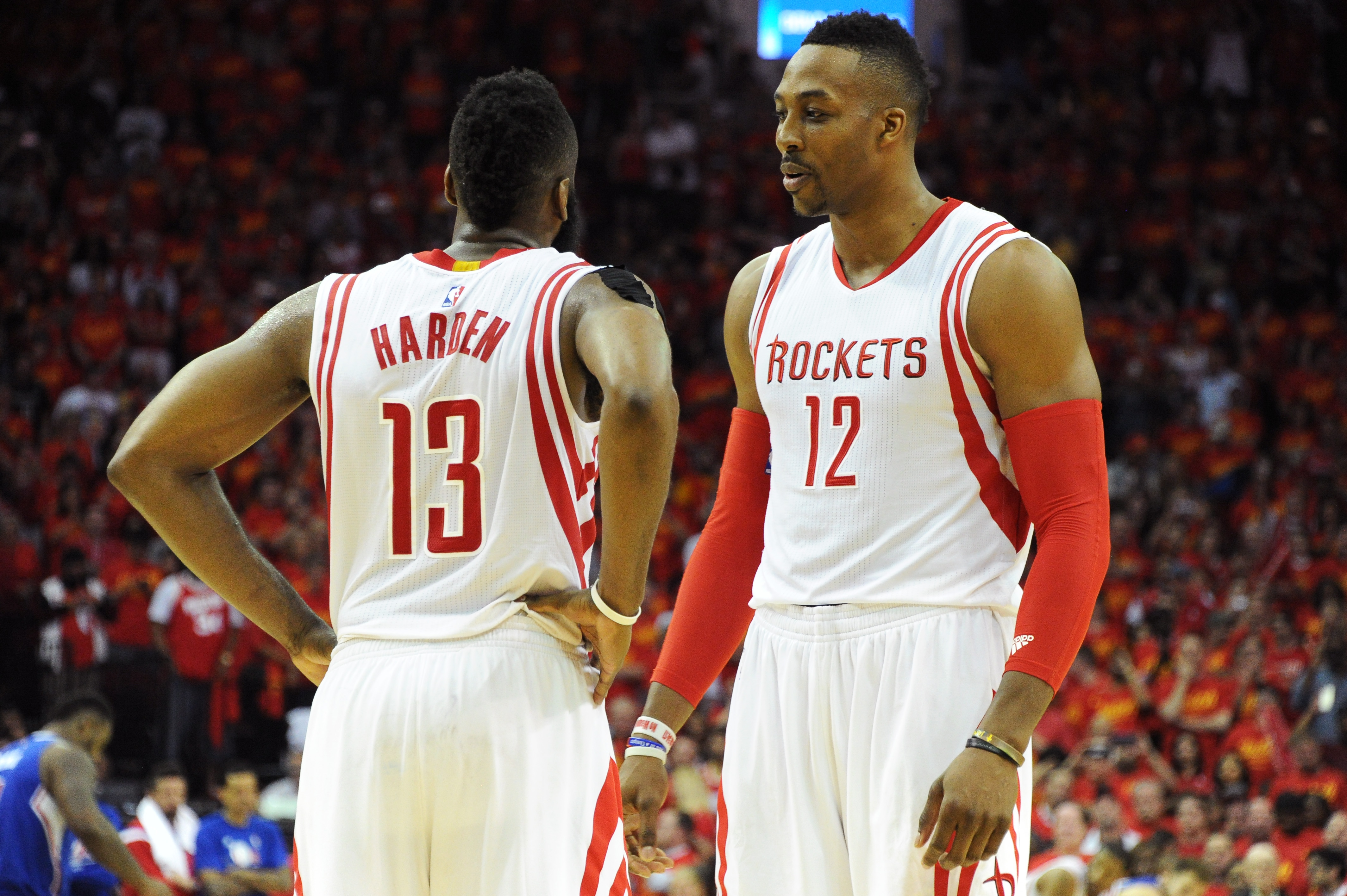 HOUSTON, TX - MAY 17: James Harden #13 and Dwight Howard #12 of the Houston Rockets stands on the court in the final seconds of the win against the Los Angeles Clippers in Game Seven of the Western Conference Semifinals during the 2015 NBA Playoffs on May