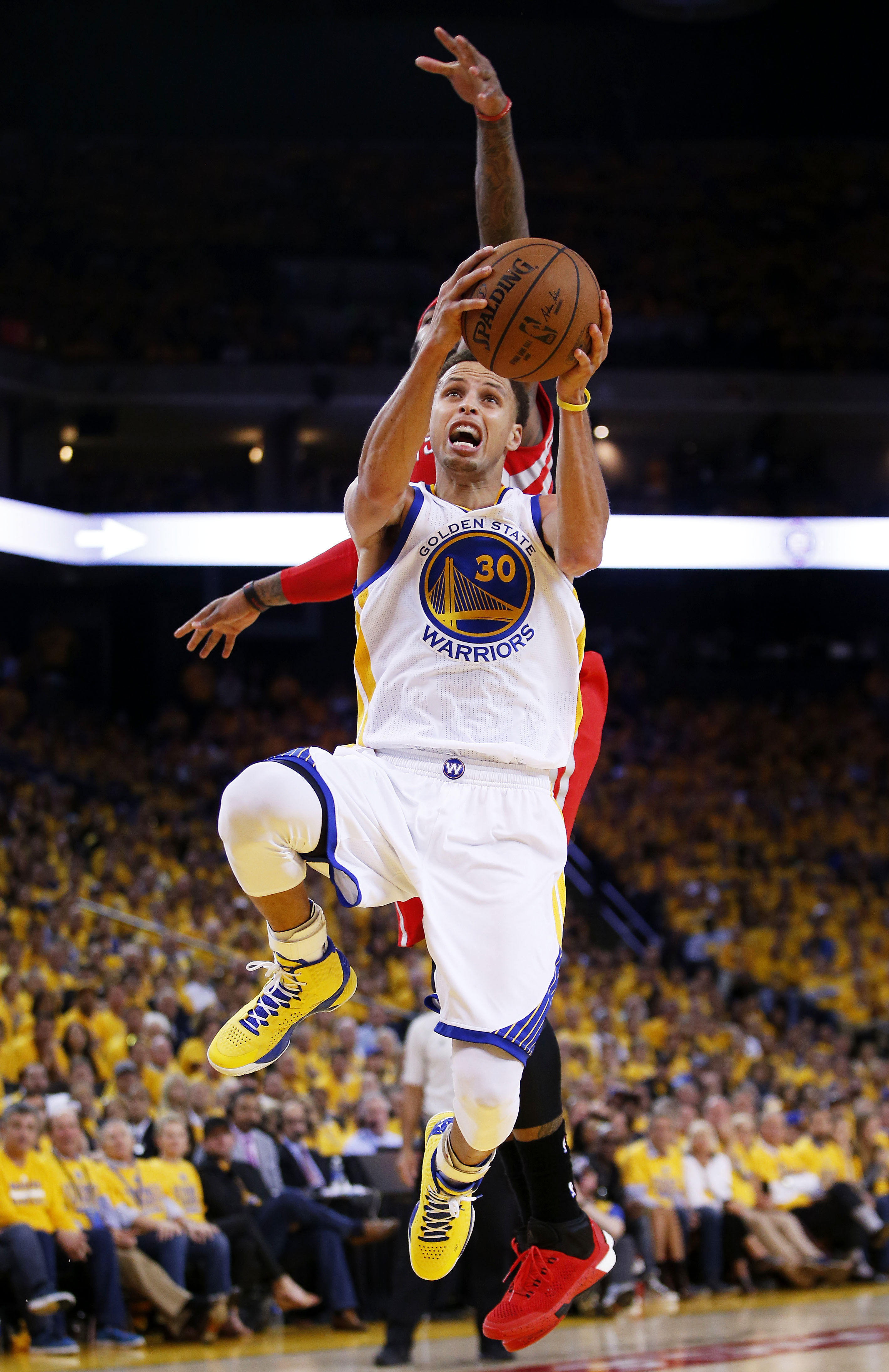 OAKLAND, CA - MAY 19:  Stephen Curry #30 of the Golden State Warriors goes up against Josh Smith #5 of the Houston Rockets in the fourth quarter during Game One of the Western Conference Finals of the 2015 NBA Playoffs at ORACLE Arena on May 19, 2015 in O