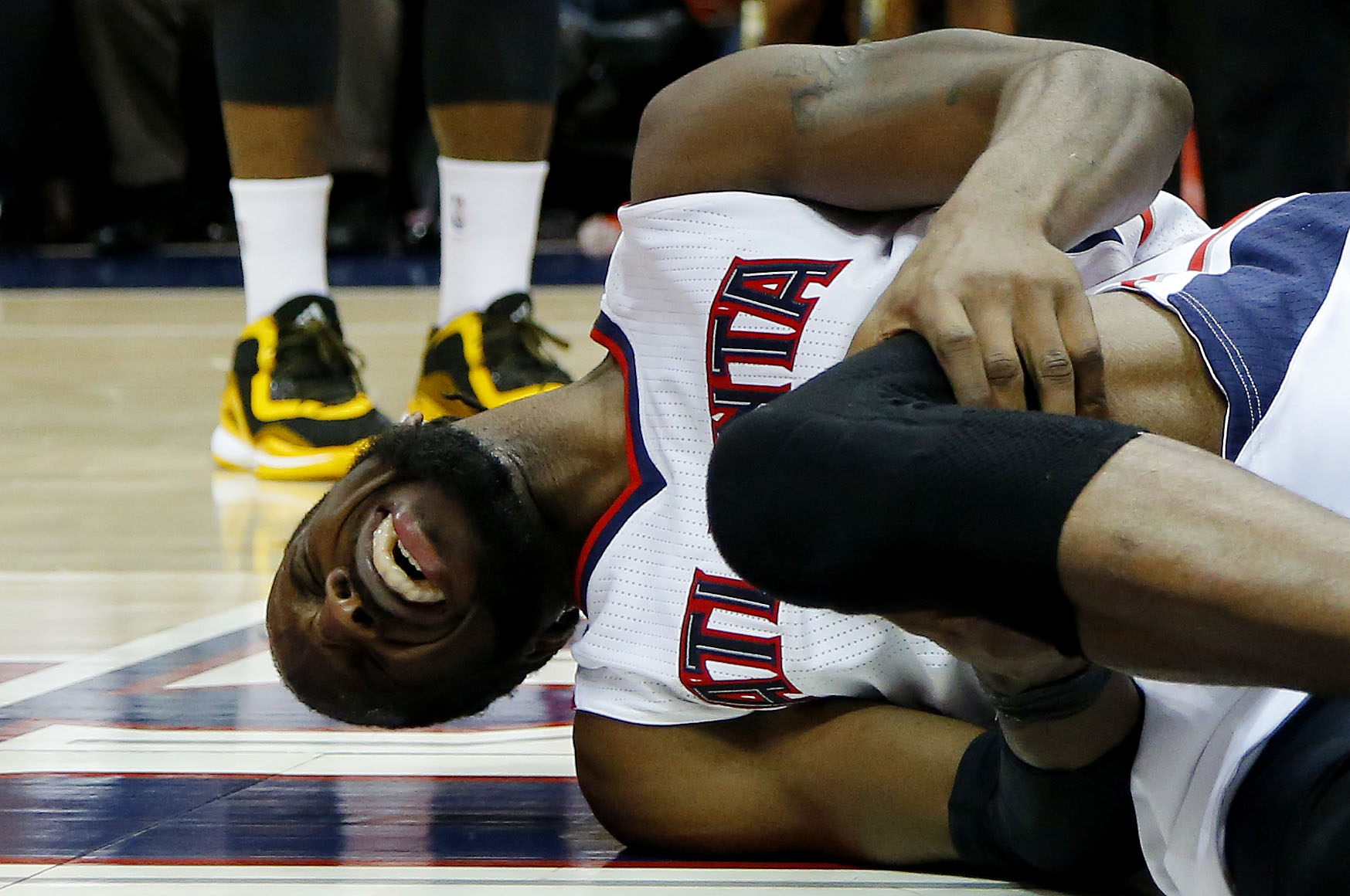 ATLANTA, GA - MAY 20:  DeMarre Carroll #5 of the Atlanta Hawks reacts after injuring his left leg in the fourth quarter against the Cleveland Cavaliers during Game One of the Eastern Conference Finals of the 2015 NBA Playoffs at Philips Arena on May 20, 2