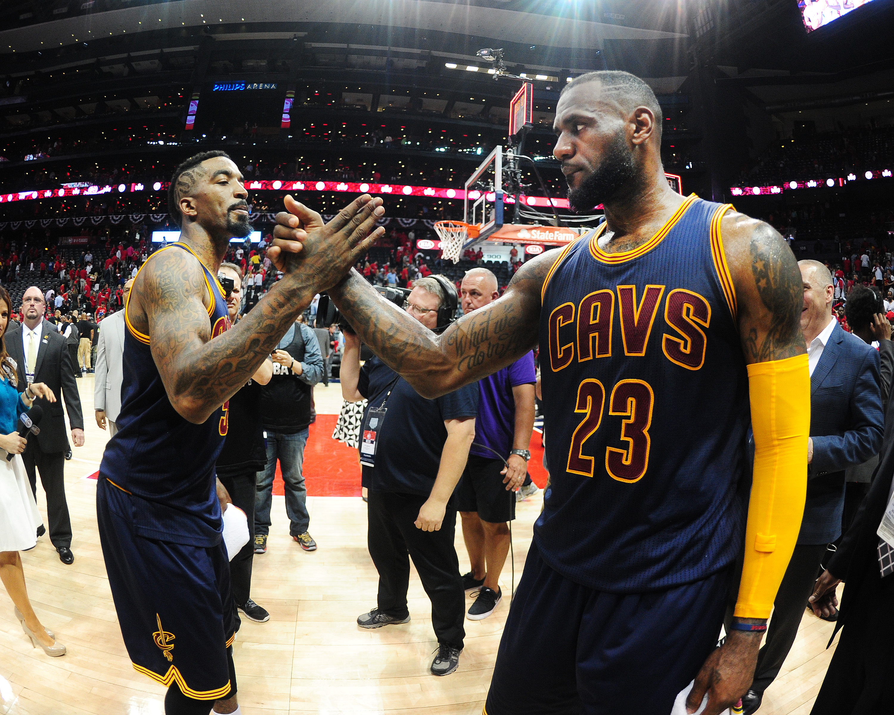 ATLANTA, GA - MAY 20: J.R. Smith #5 high fives LeBron James #23 of the Cleveland Cavaliers after the win for Game One of the Eastern Conference Finals during the NBA Playoffs on May 20, 2015 at Philips Arena in Atlanta, Georgia.  (Photo by Scott Cunningha