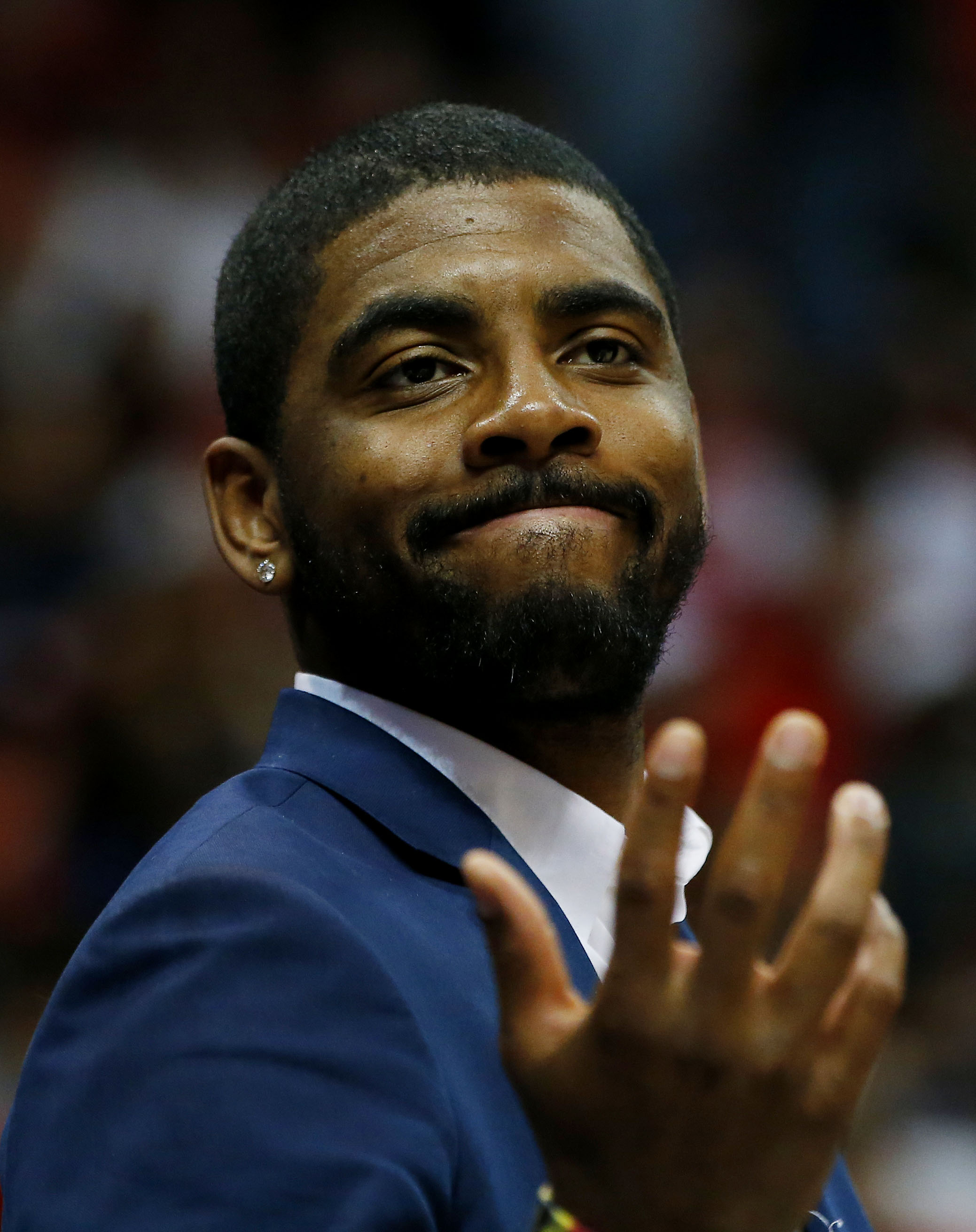 ATLANTA, GA - MAY 22:  Kyrie Irving #2 of the Cleveland Cavaliers reacts on the bench after Tristan Thompson #13 dunked against the Atlanta Hawks in the fourth quarter during Game Two of the Eastern Conference Finals of the 2015 NBA Playoffs at Philips Ar