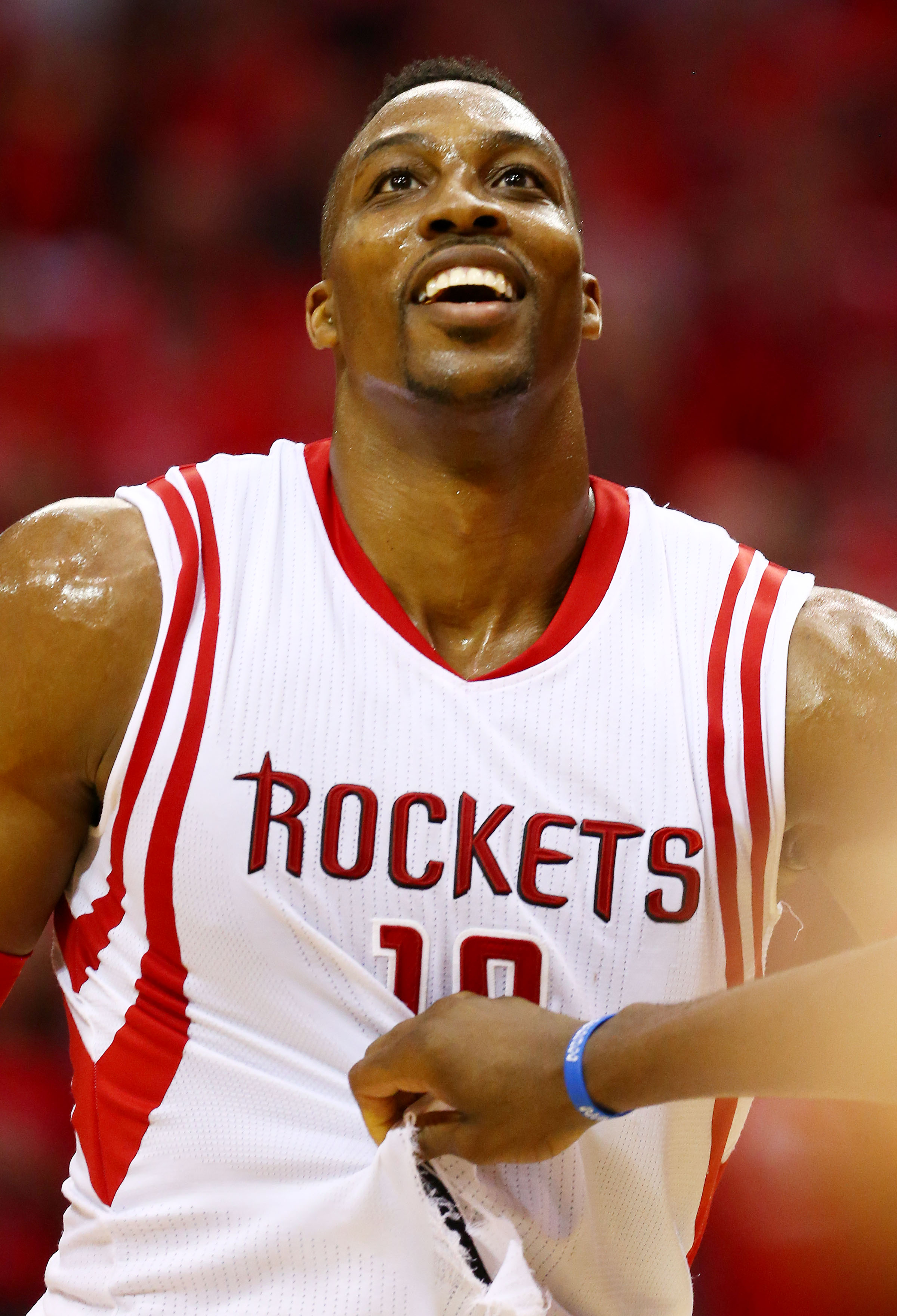 HOUSTON, TX - MAY 25:  Dwight Howard #12 of the Houston Rockets wears a ripped jersey in the second quarter against the Golden State Warriors during Game Four of the Western Conference Finals of the 2015 NBA Playoffs at Toyota Center on May 25, 2015 in Ho