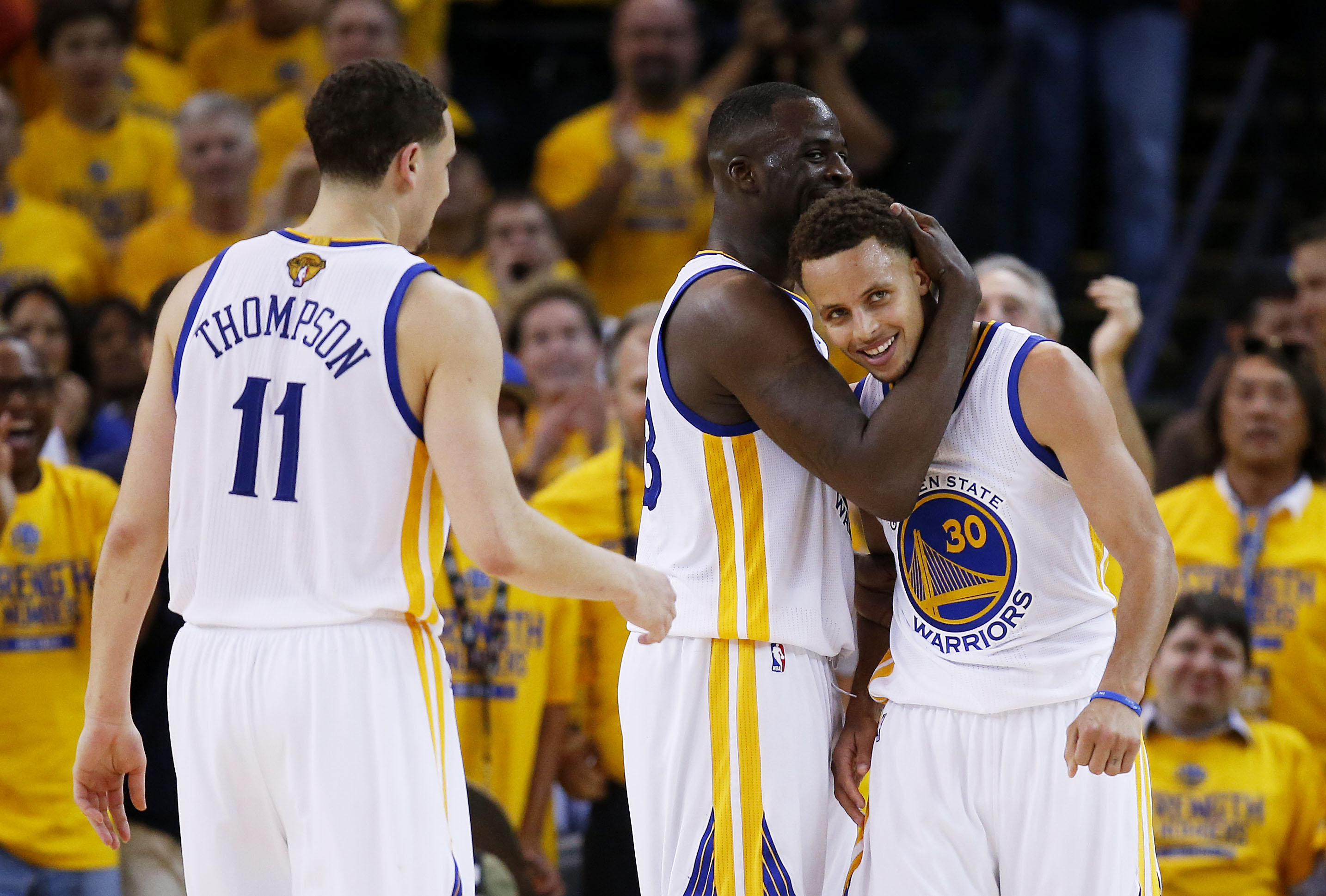 OAKLAND, CA - JUNE 14:  Stephen Curry #30 Draymond Green #23 and Klay Thompson #11 of the Golden State Warriors celebrate late in their 109 to 91 win over the Cleveland Cavaliers during Game Five of the 2015 NBA Finals at ORACLE Arena on June 14, 2015 in