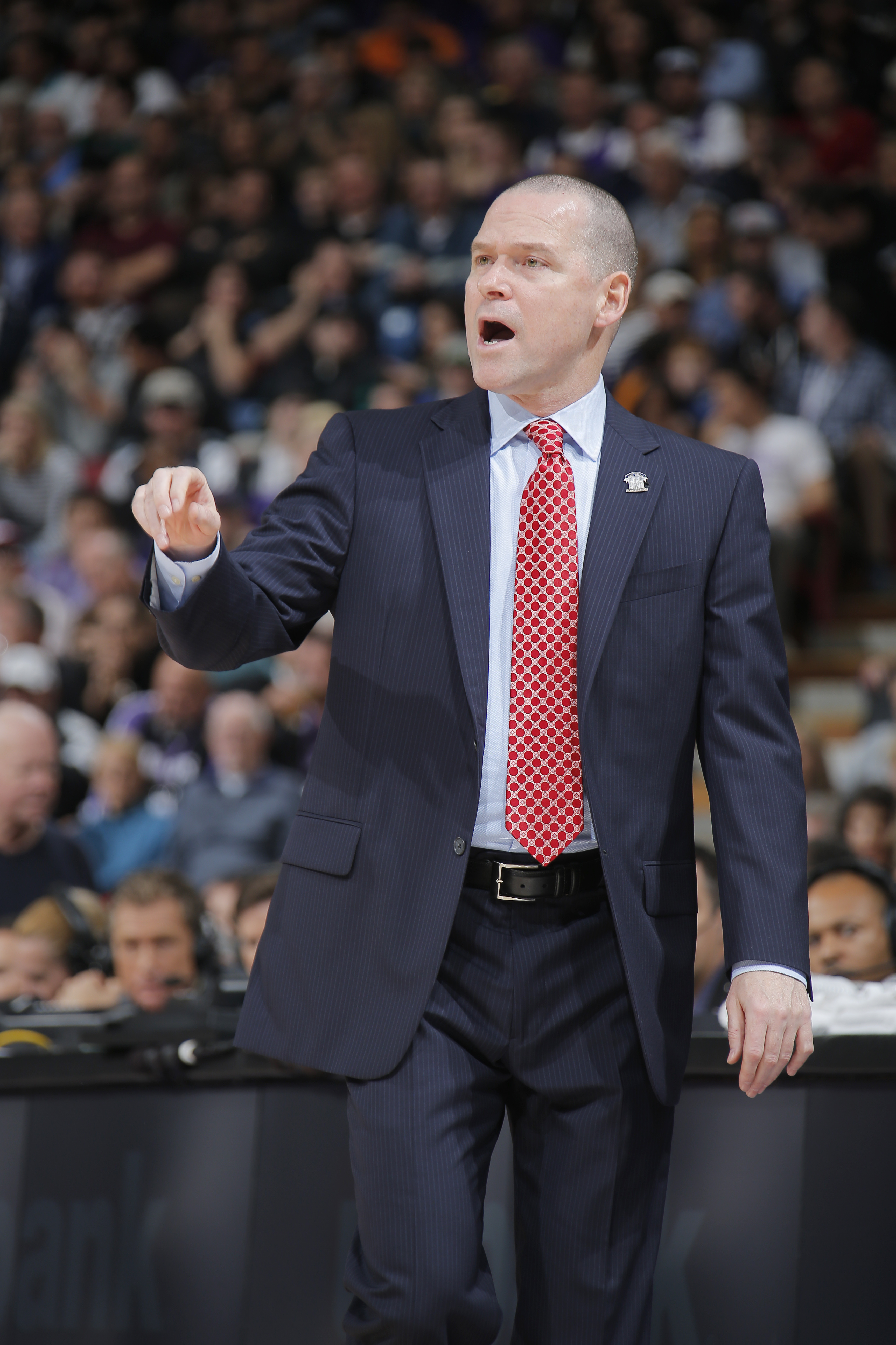 SACRAMENTO, CA - DECEMBER 2: Michael Malone Head Coach of the Sacramento Kings stands on the court during a game against the Toronto Raptors on December 2, 2014 at Sleep Train Arena in Sacramento, California. (Photo by Rocky Widner/NBAE via Getty Images)