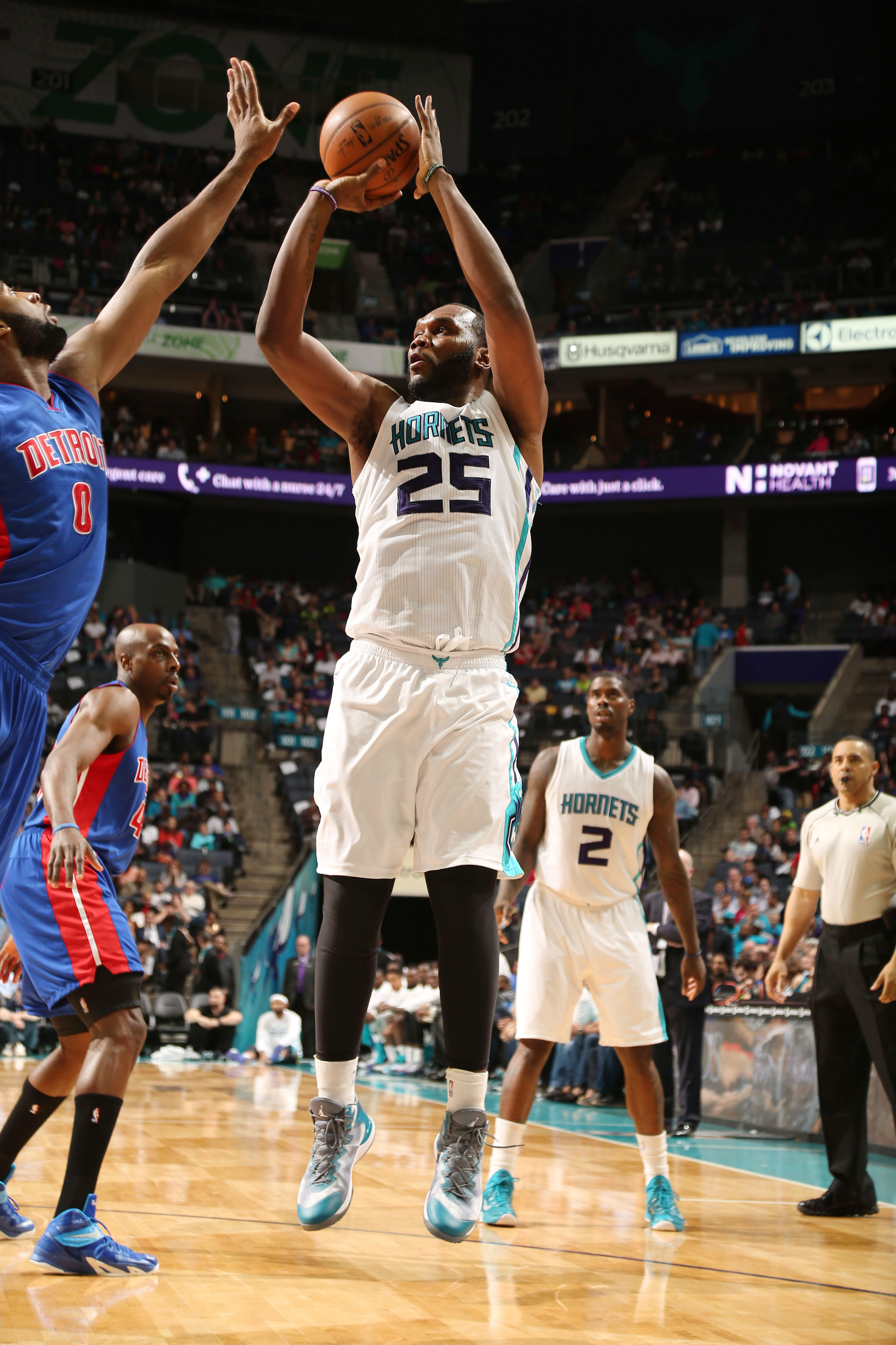 CHARLOTTE, NC - APRIL 1:  Al Jefferson #25 of the Charlotte Hornets shoots against Andre Drummond #0 of the Detroit Pistons during the game at the Time Warner Cable Arena on April 1, 2015 in Charlotte, North Carolina. (Photo by Brock Williams-Smith/NBAE v
