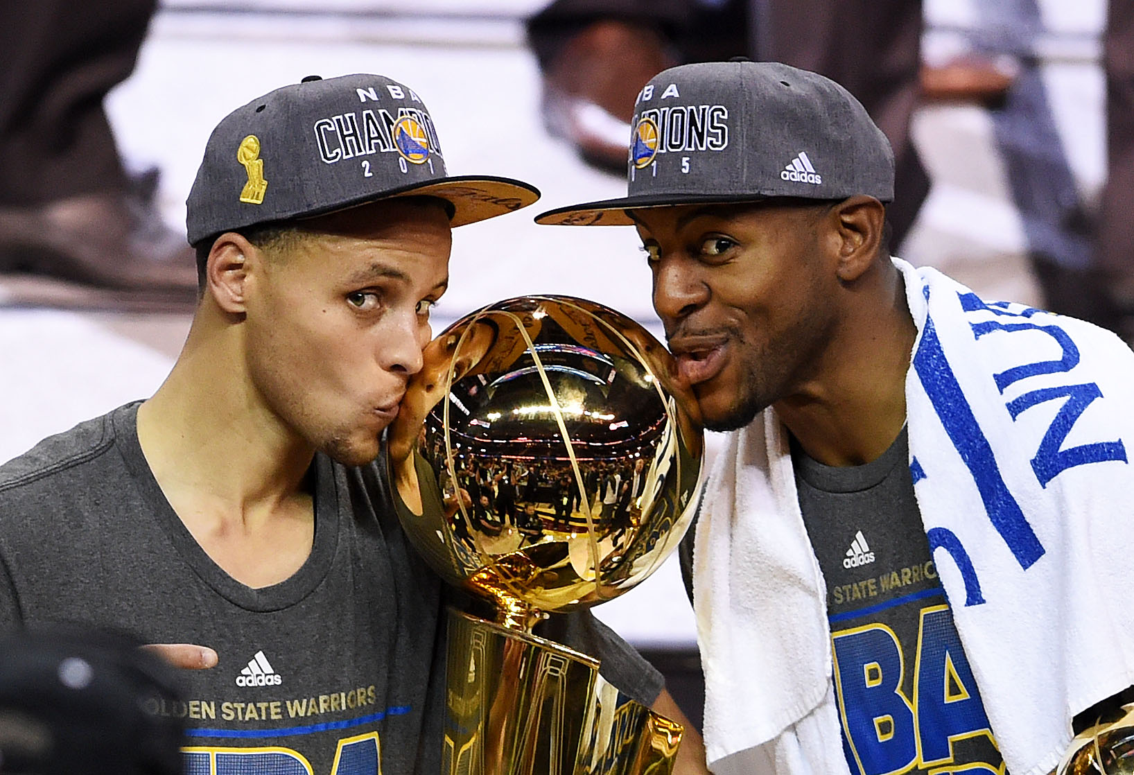 CLEVELAND, OH - JUNE 16:  Stephen Curry #30 and Andre Iguodala #9 of the Golden State Warriors celebrate with the Larry O'Brien NBA Championship Trophy after defeating the Cleveland Cavaliers in Game Six of the 2015 NBA Finals at Quicken Loans Arena on Ju