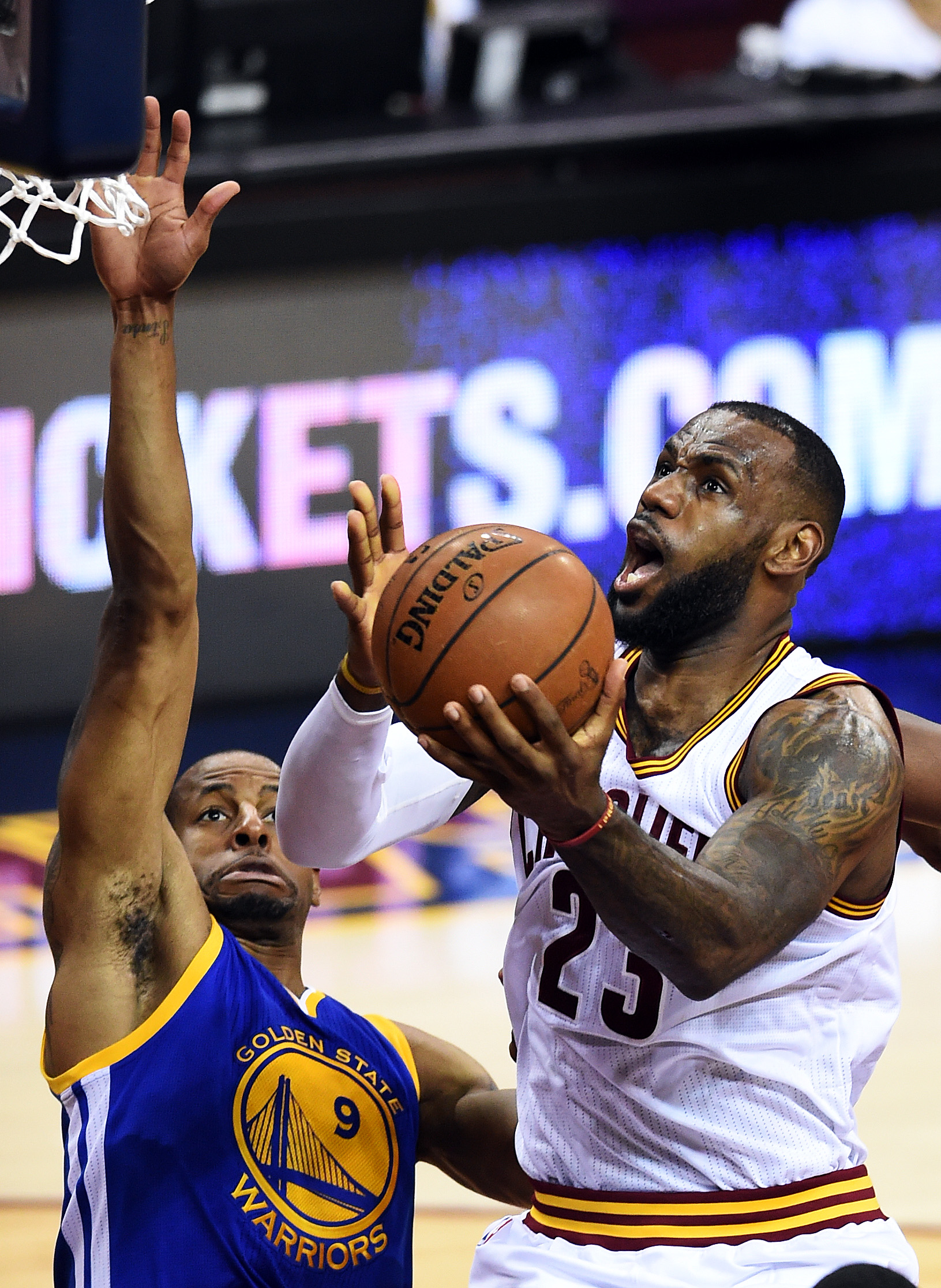 CLEVELAND, OH - JUNE 16:  LeBron James #23 of the Cleveland Cavaliers goes up against Andre Iguodala #9 of the Golden State Warriors during Game Six of the 2015 NBA Finals at Quicken Loans Arena on June 16, 2015 in Cleveland, Ohio. (Photo by Jason Miller/