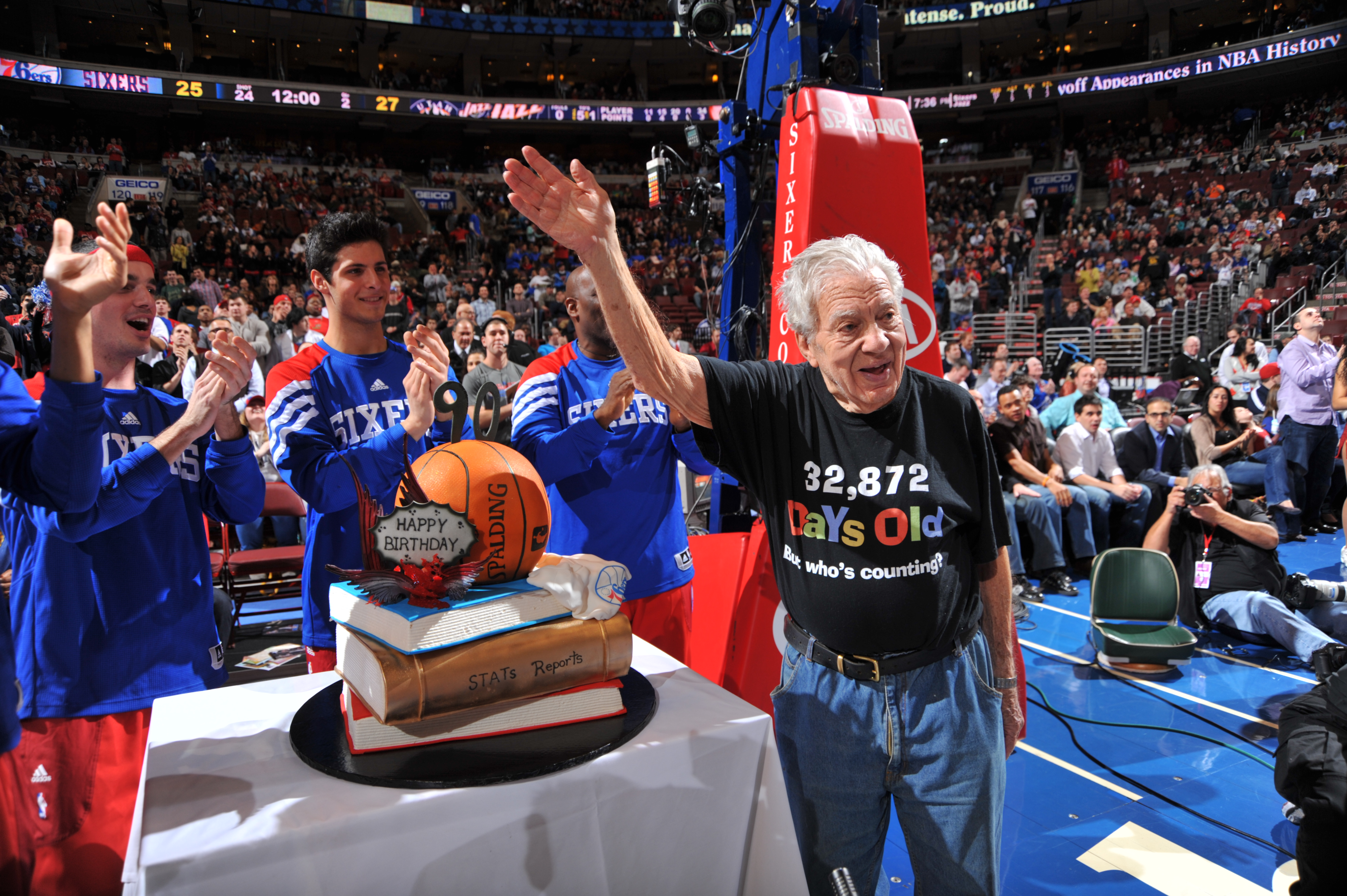 PHILADELPHIA, PA - MARCH 9: Harvey Pollack, Director of statistical information for the Philadelphia 76ers is acknowledged on his 90th Birthday during a break in the action against the Utah Jazz on March 9, 2012 at the Wells Fargo Center in Philadelphia,