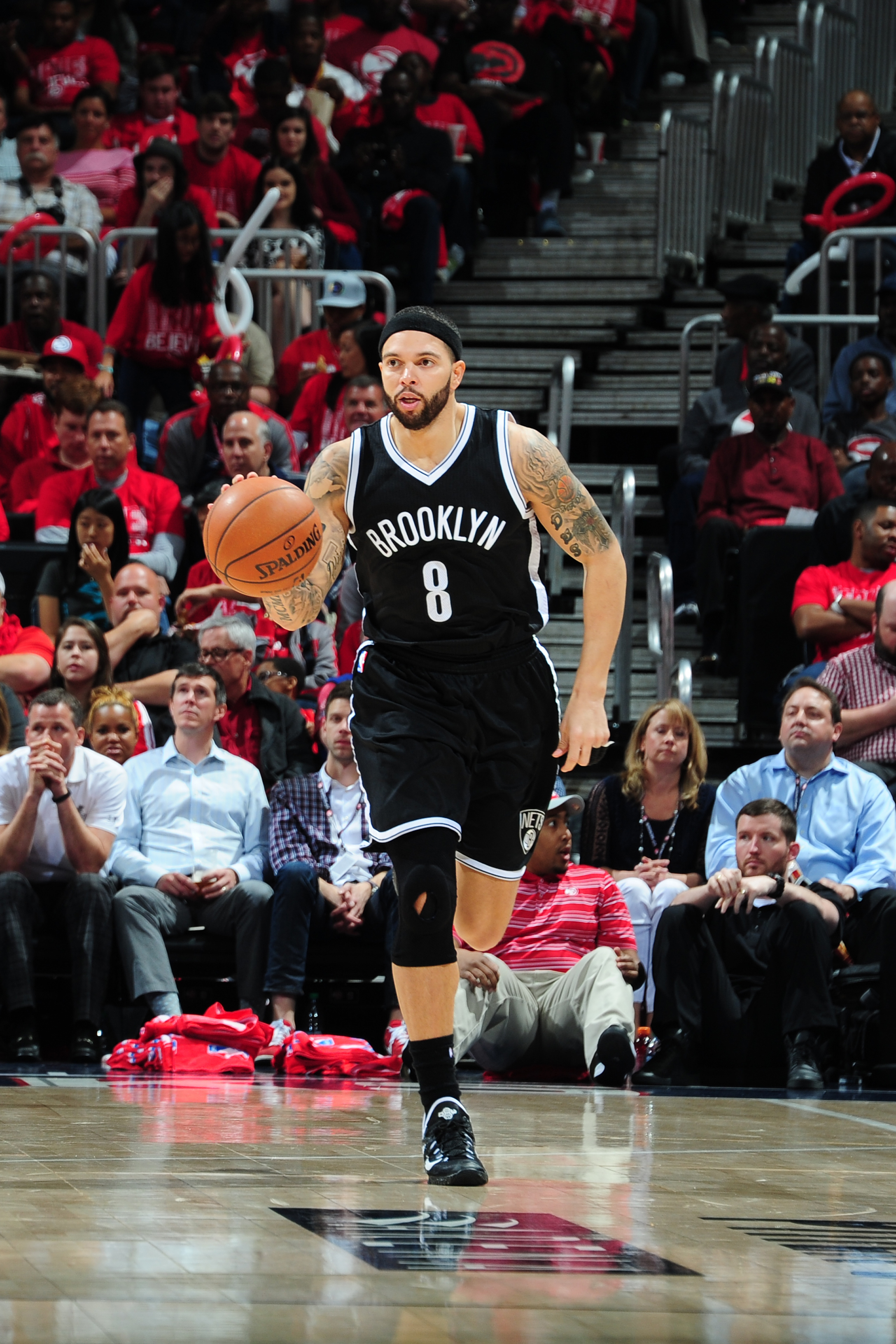 ATLANTA, GA - APRIL 29:  Deron Williams #8 of the Brooklyn Nets handles the ball against the Atlanta Hawks in Game Five of the Eastern Conference Quarterfinals during the 2015 NBA Playoffs on April 29, 2015 at Philips Arena in Atlanta, Georgia.  (Photo by