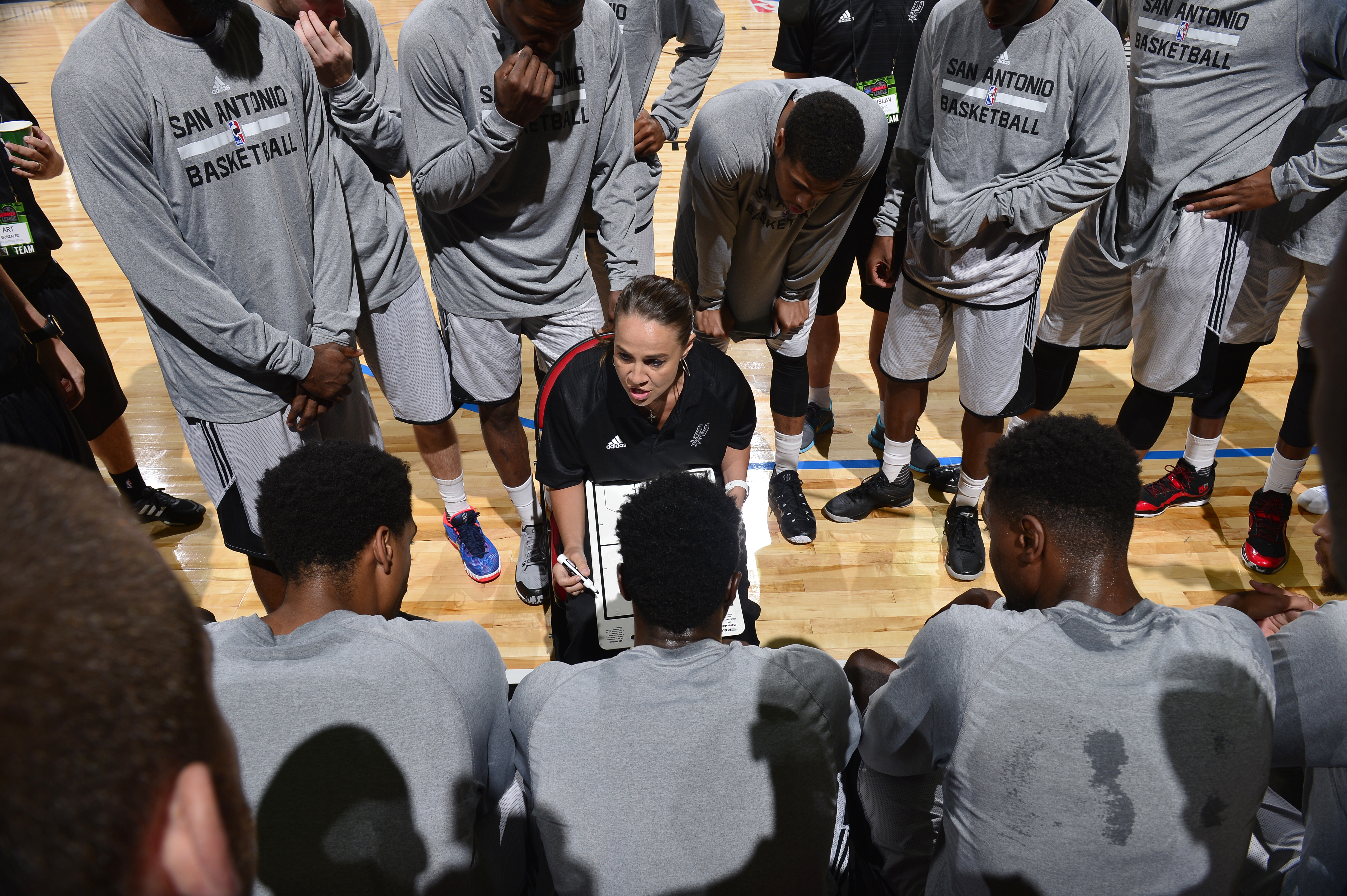 LAS VEGAS, NV - JULY 11: San Antonio Spurs head coach, Becky Hammon directs a play against the New York Knicks during the game on July 11, 2015 at Thomas And Mack Center, Las Vegas, Nevada.  (Photo by David Dow/NBAE via Getty Images)