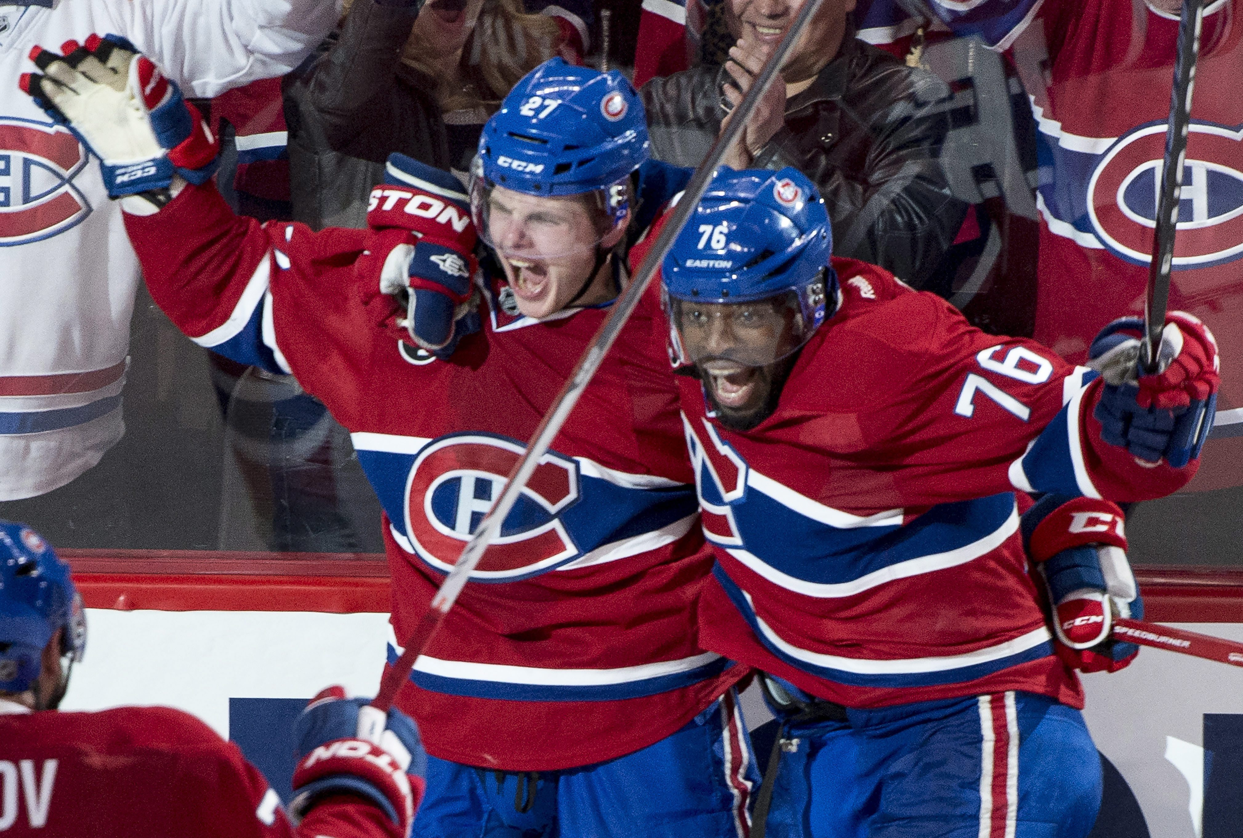 Montreal Canadiens' Alex Galchenyuk, left, celebrates his winning goal over the Ottawa Senators with teammate P.K. Subban during first period overtime in Game 2 of an NHL hockey first-round playoff series, Friday, April 17, 2015 in Montreal. (Paul Chiasso