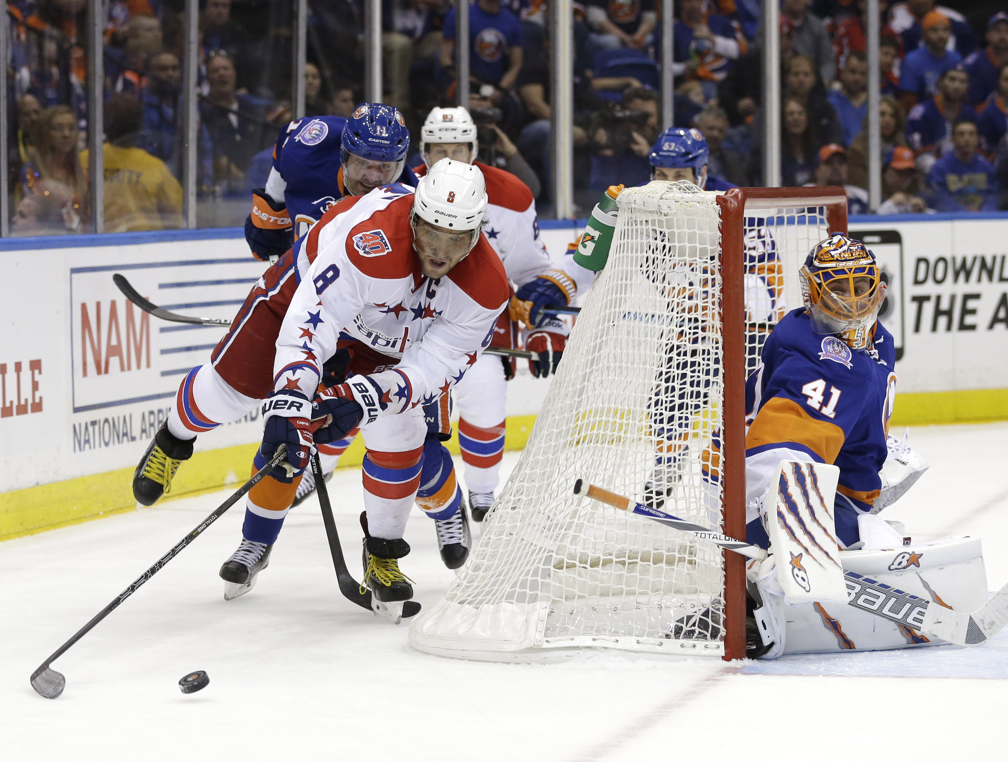 New York Islanders goalie Jaroslav Halak, right, looks on as Washington Capitals' Alex Ovechkin comes around the back of the net during the third period of Game 3 of a first-round NHL hockey playoff series, Sunday, April 19, 2015, in Uniondale, N.Y. (AP P