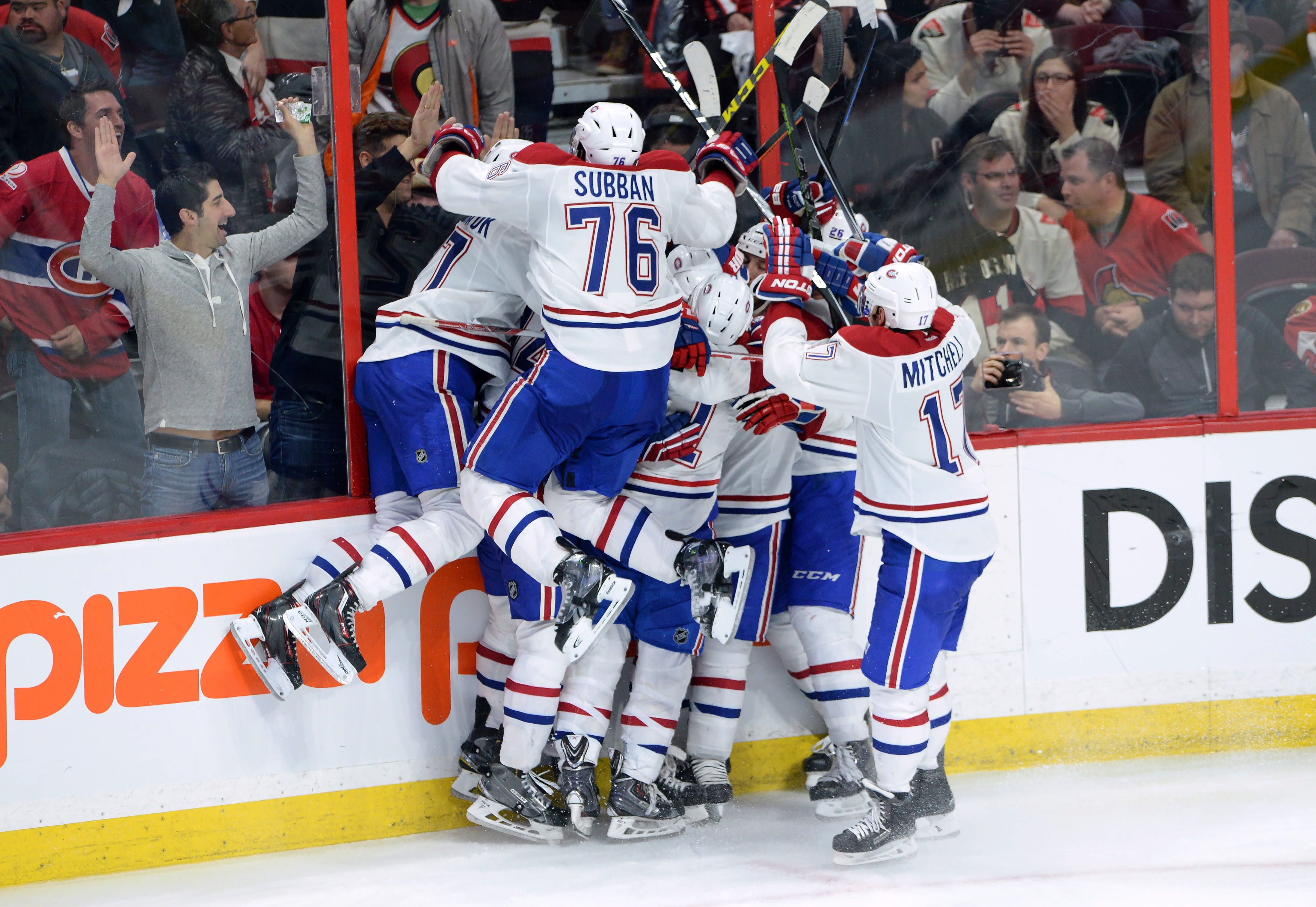 The Montreal Canadiens celebrate their sudden death overtime win over the Ottawa Senators in game 3 of first round Stanley Cup NHL playoff hockey action in Ottawa, Ontario, on Sunday, April 19, 2015.  (Sean Kirkpatrick/The Canadian Press via AP)   MANDATO